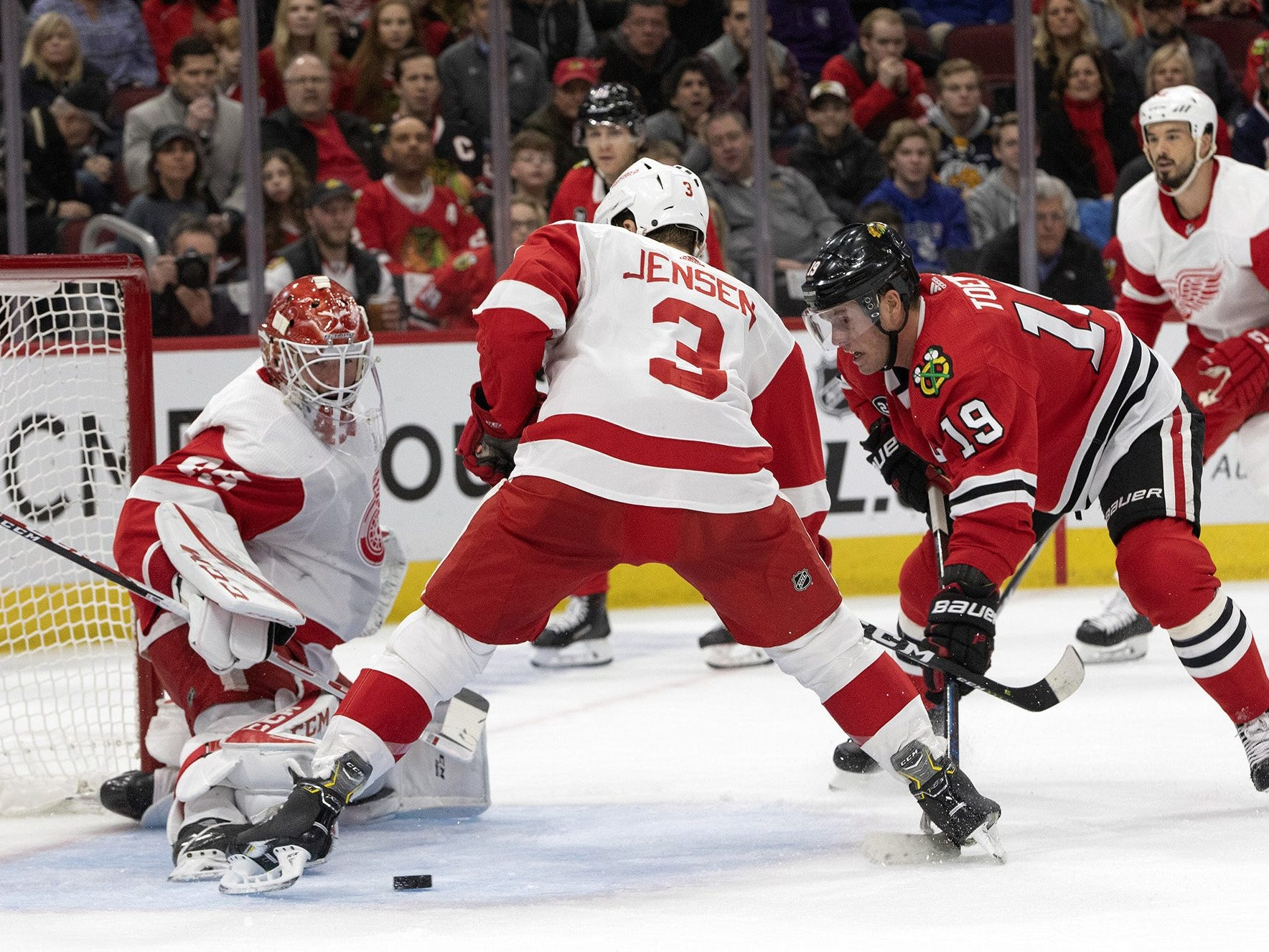 A shot by Chicago Blackhawks center Jonathan Toews is blocked in front of Detroit Red Wings goalie Jonathan Bernier in the first period Sunday, Feb. 10, 2019, at the United Center in Chicago.