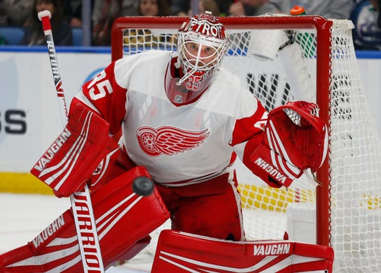 Detroit Red Wings goalie Jimmy Howard watches the puck during the third period against the Buffalo Sabres, Saturday, Feb. 9, 2019, in Buffalo N.Y.