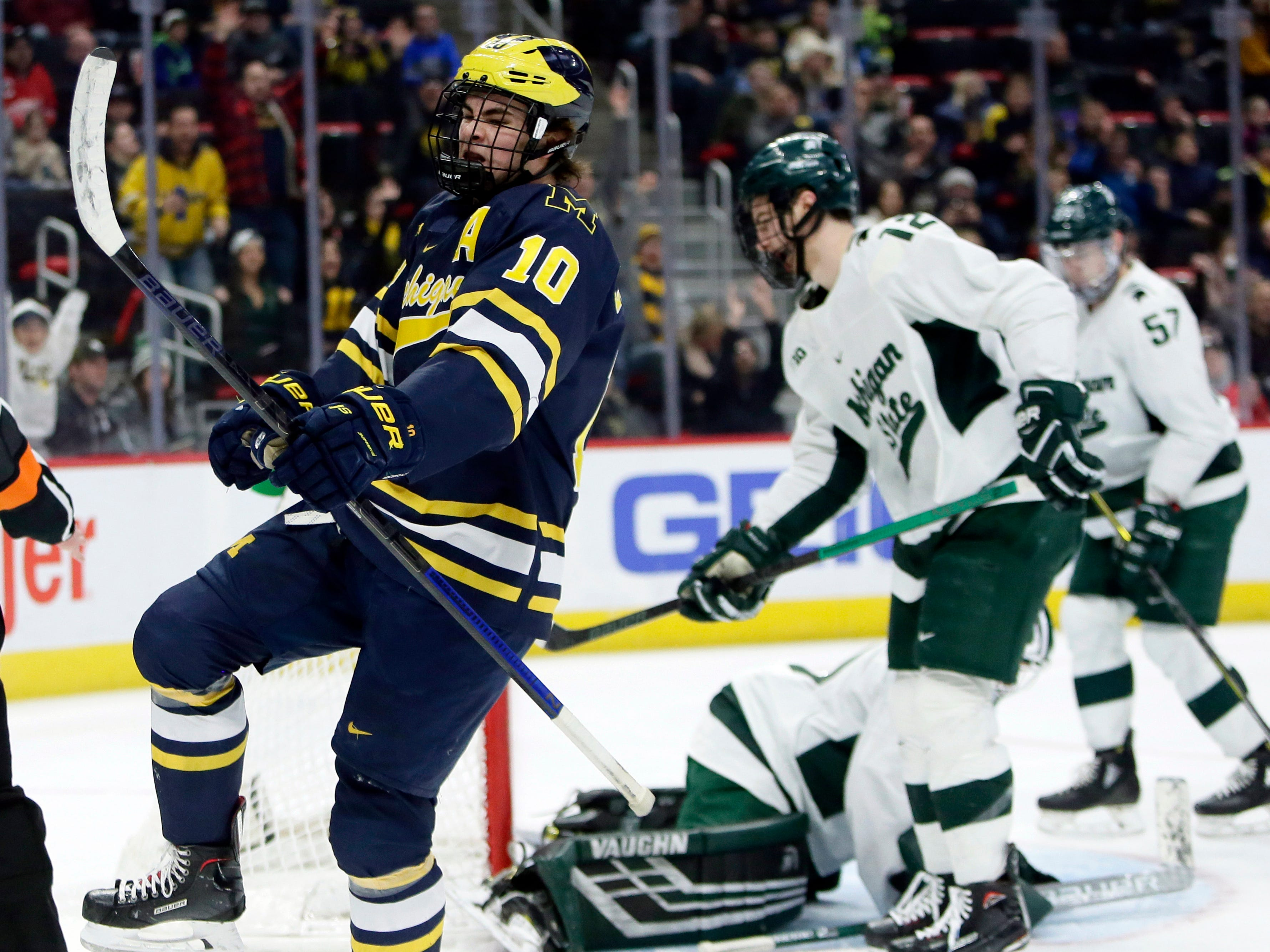 Michigan forward Will Lockwood celebrates after scoring against Michigan State during the first period on Saturday, Feb. 9, 2019, at Little Caesars Arena.