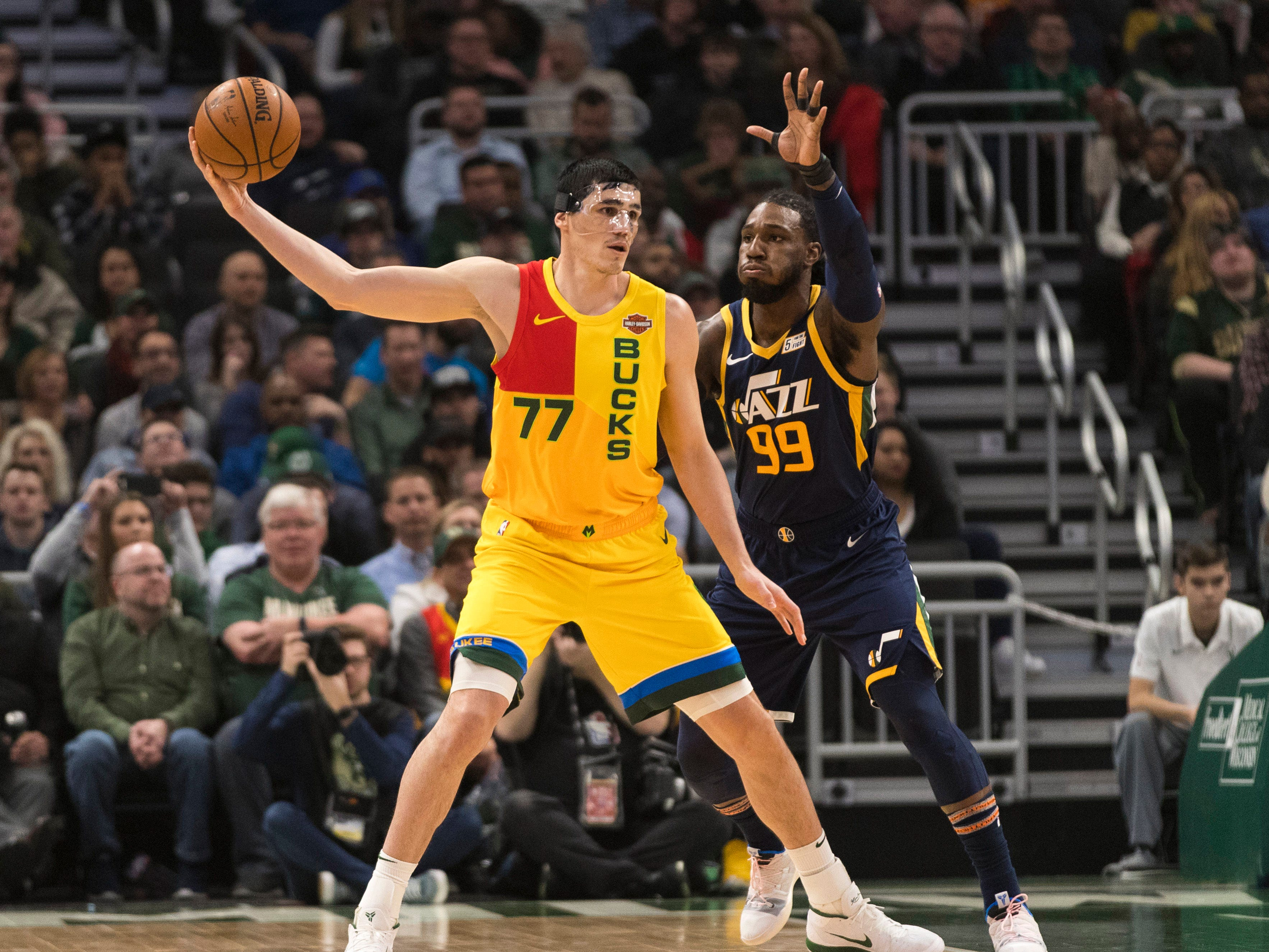 Milwaukee Bucks forward Ersan Ilyasova holds the ball away from Utah Jazz forward Jae Crowder at Fiserv Forum, Jan. 7, 2019 in Milwaukee.