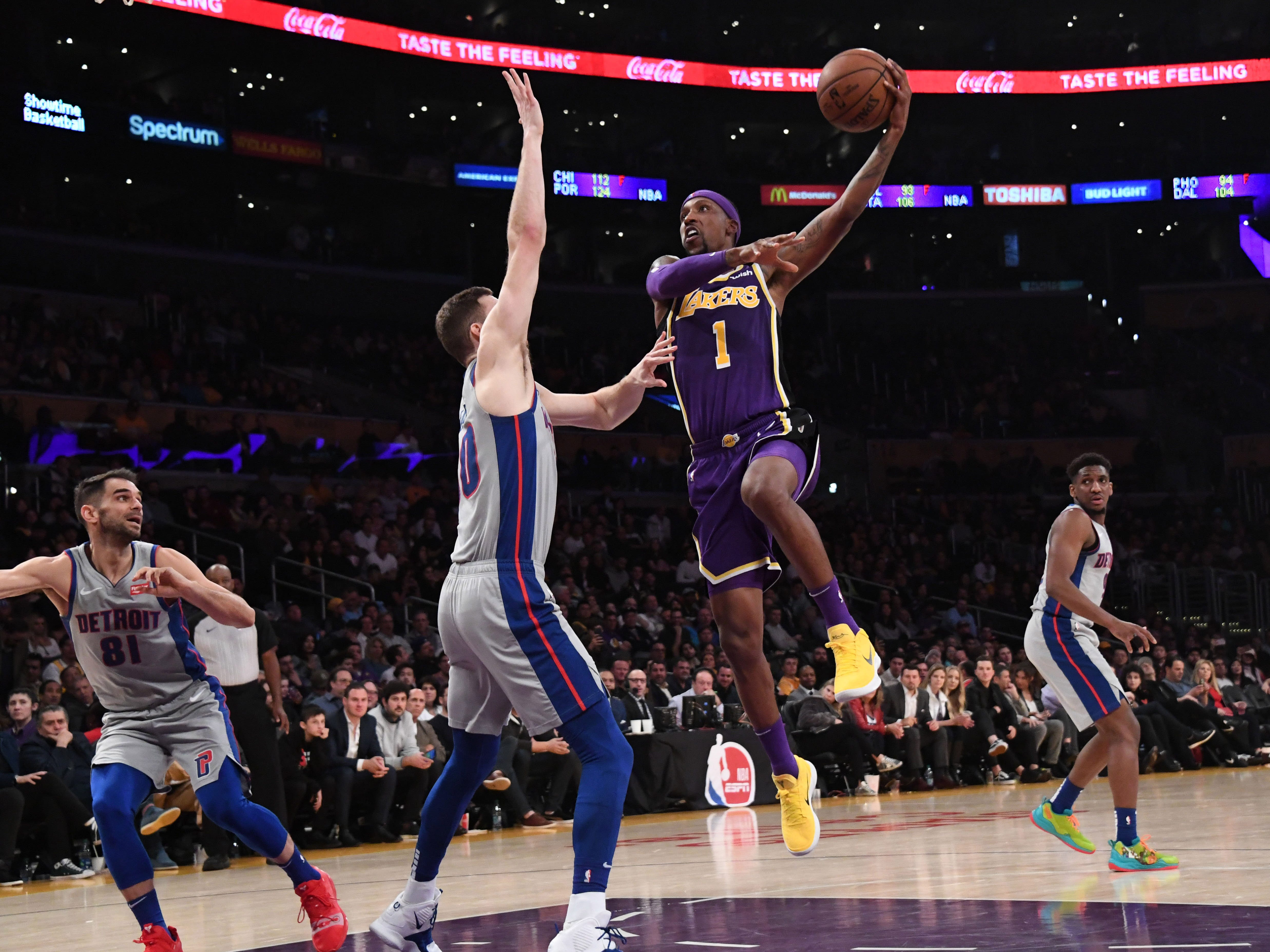 Los Angeles Lakers guard Kentavious Caldwell-Pope is defended by Detroit Pistons forward Jon Leuer at the Staples Center, Jan. 9, 2019.