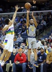Memphis Grizzlies guard Avery Bradley shoots against New Orleans Pelicans guard Frank Jackson in Memphis, Feb. 9, 2019.