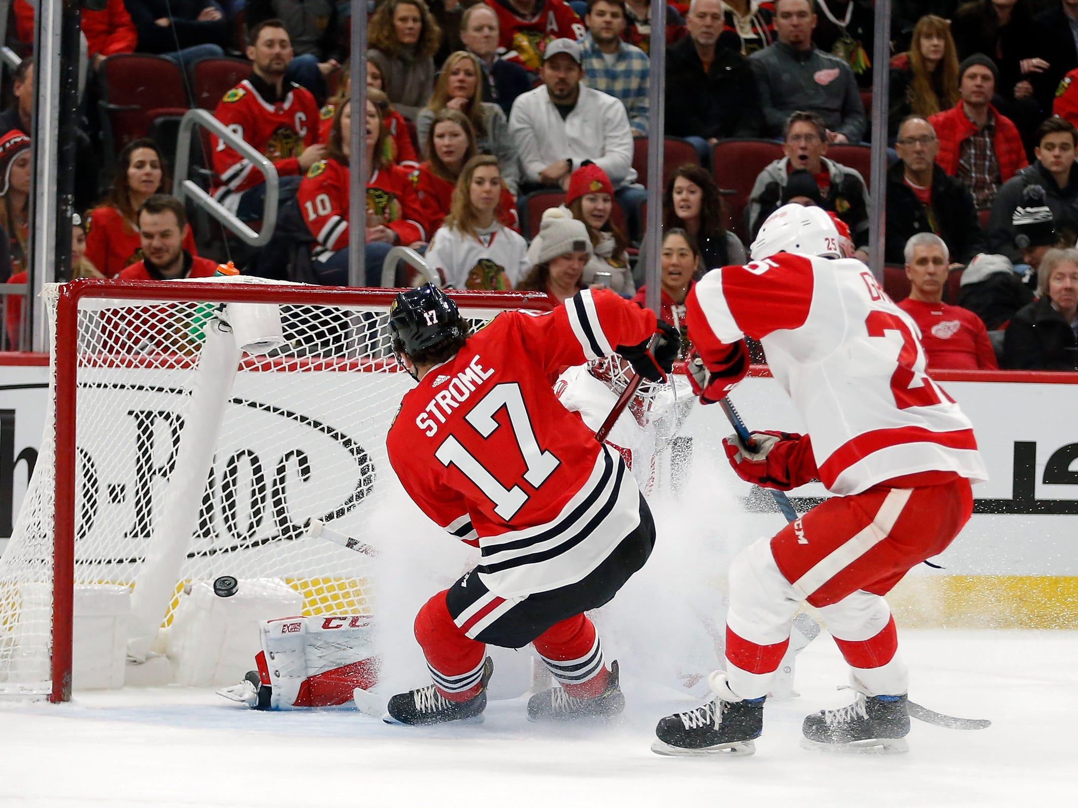 Chicago Blackhawks center Dylan Strome scores against Detroit Red Wings goaltender Jonathan Bernier during the first period at United Center, Feb. 10, 2019.