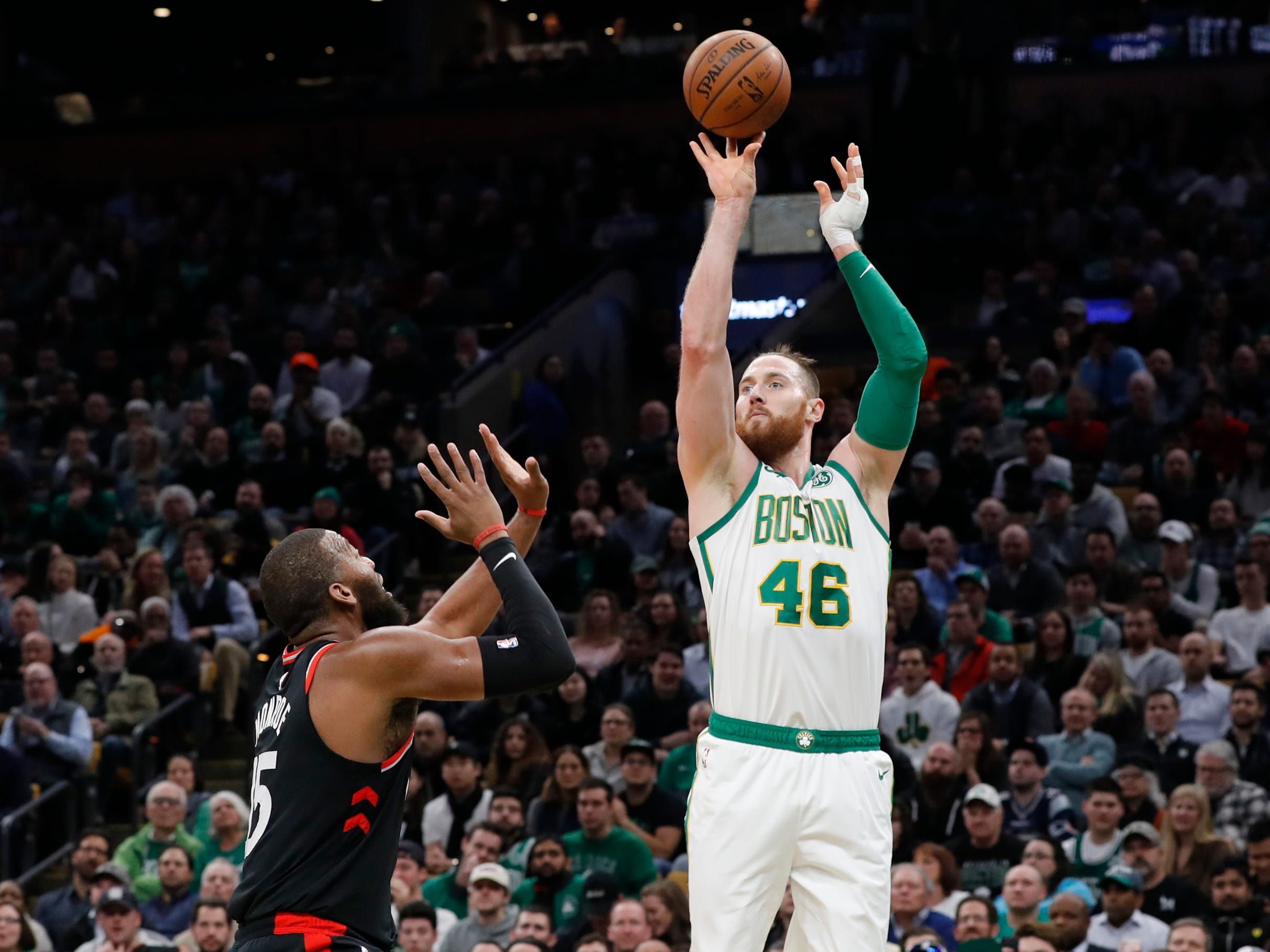 Boston Celtics center Aron Baynes shoots against the Toronto Raptors at TD Garden in Boston, Jan. 16, 2019.