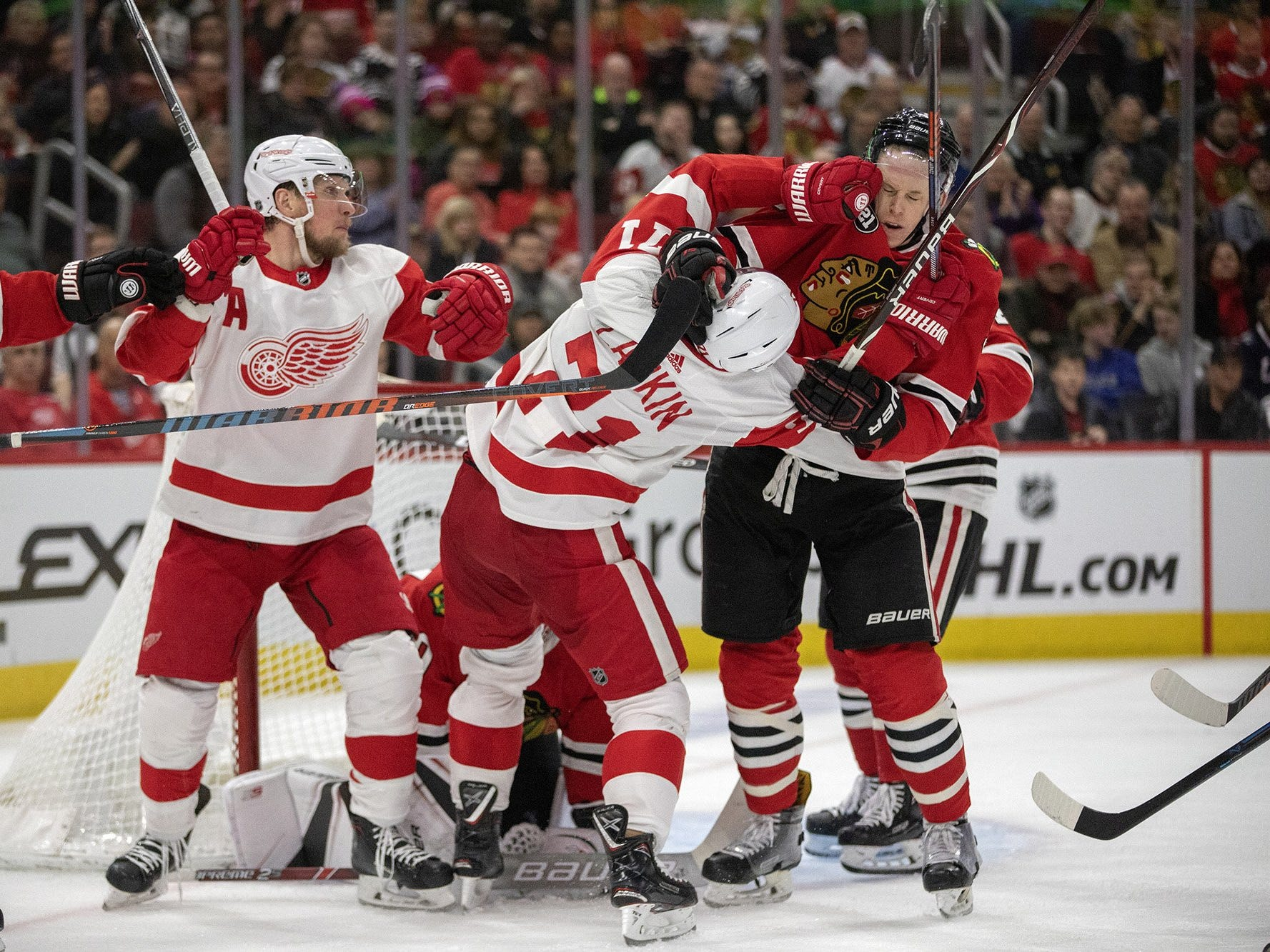 Detroit Red Wings center Dylan Larkin and Chicago Blackhawks defenseman Connor Murphy get in a scuffle during the second period on Sunday, Feb. 10, 2019, at the United Center in Chicago.