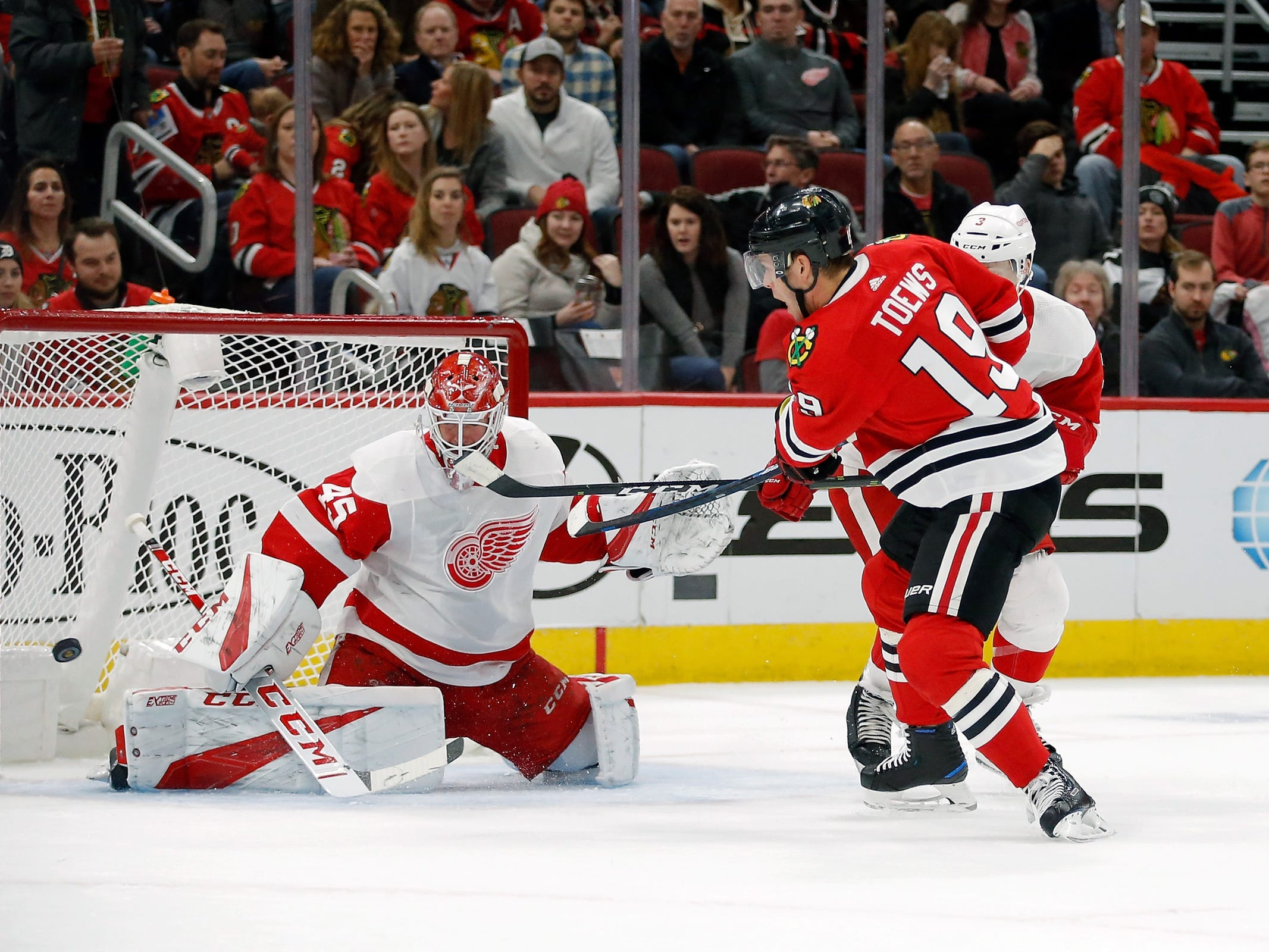 Chicago Blackhawks center Jonathan Toews shoots and misses against Detroit Red Wings goaltender Jonathan Bernier during the first period at United Center, Feb. 10, 2019.