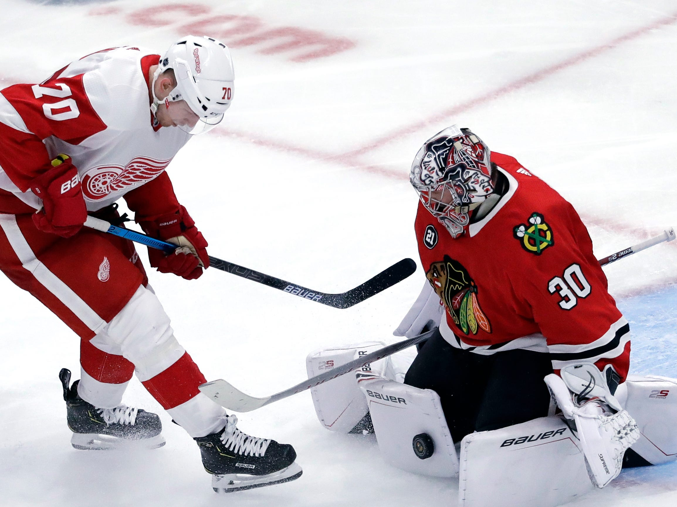Chicago Blackhawks goalie Cam Ward, right, blocks a shot by Detroit Red Wings center Christoffer Ehn during the third period Sunday, Feb. 10, 2019, in Chicago.