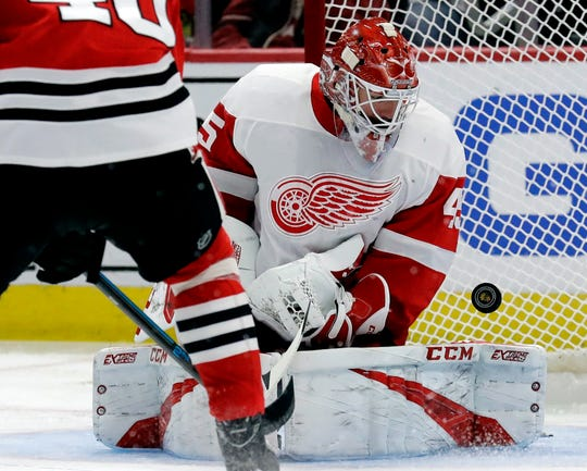 Detroit Red Wings goalie Jonathan Bernier blocks a shot against the Chicago Blackhawks during the second period Sunday.