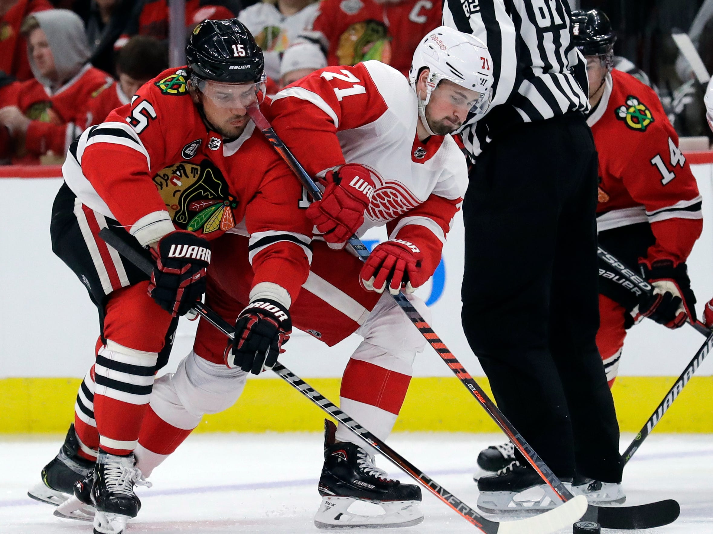 Detroit Red Wings center Dylan Larkin (71) battles for the puck against Chicago Blackhawks center Artem Anisimov (15) during the second period.