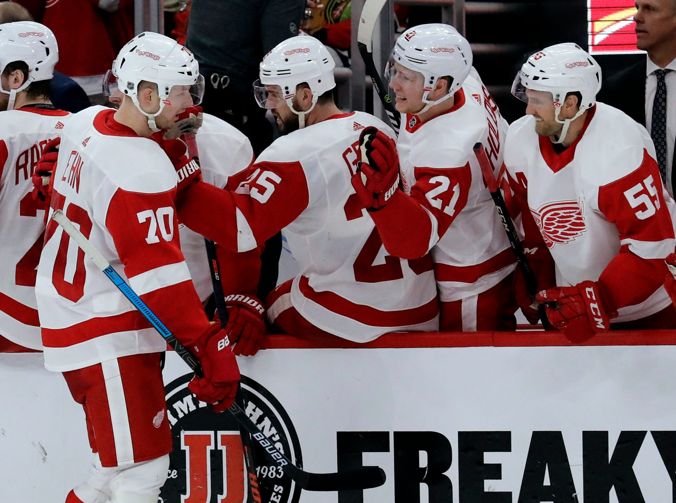 Detroit Red Wings center Christoffer Ehn (70) celebrates with teammates after scoring a goal against the Chicago Blackhawks during the second period.