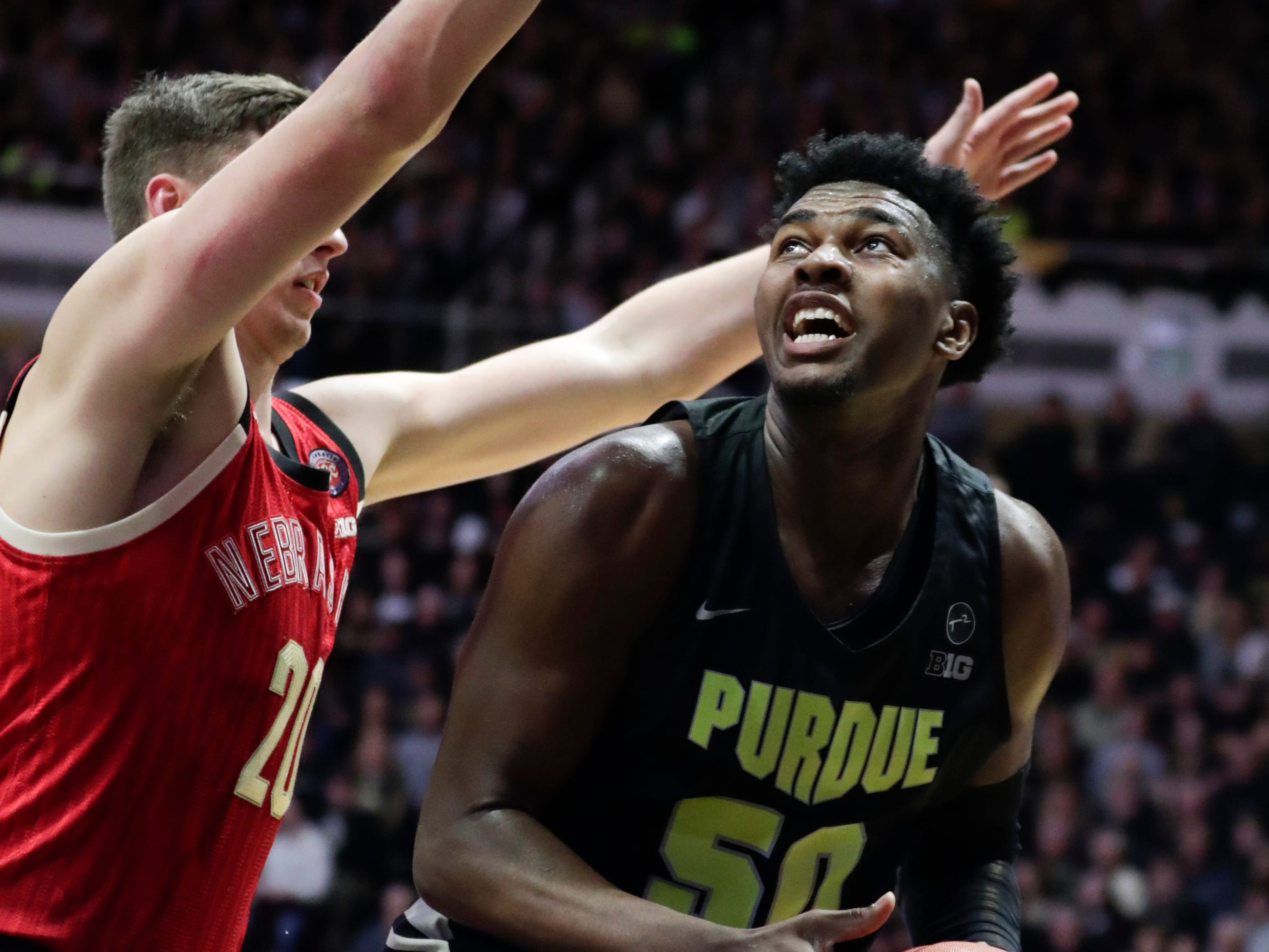 Purdue forward Trevion Williams (50) looks to shoot over Nebraska forward Tanner Borchardt (20) during the first half of an NCAA college basketball game in West Lafayette, Ind., Saturday, Feb. 9, 2019. (AP Photo/Michael Conroy)