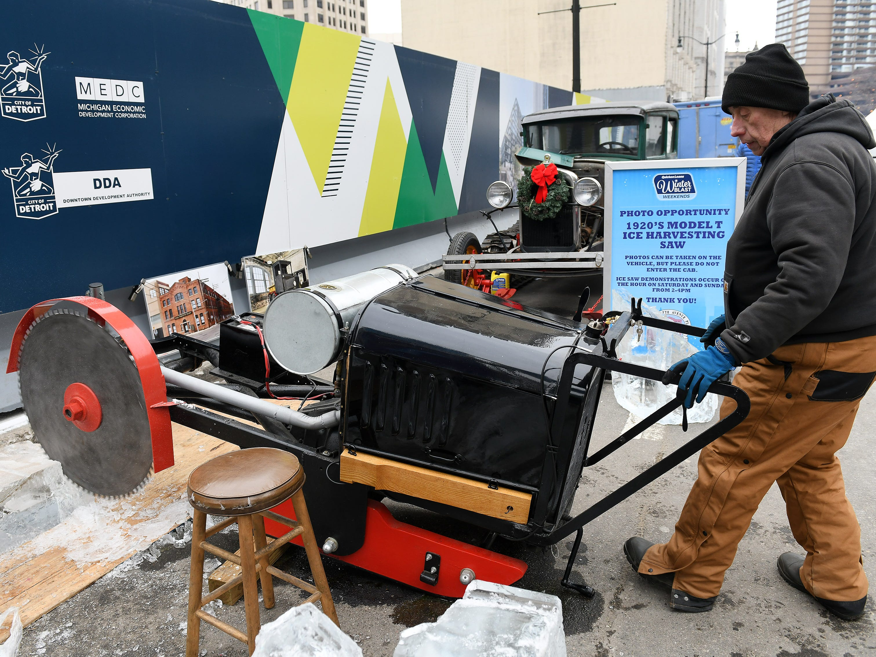 Ford Piquette Avenue Plant volunteer Randy Shelton of Dearborn demonstrates the 1920s Model T ice harvesting saw.