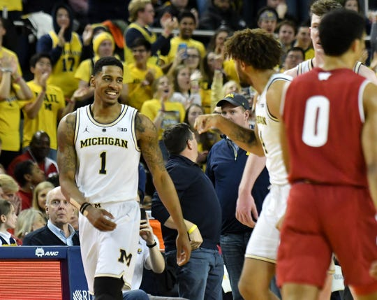 Michigan guard Charles Matthews smiles late in the second half of Michigan's win over Wisconsin.