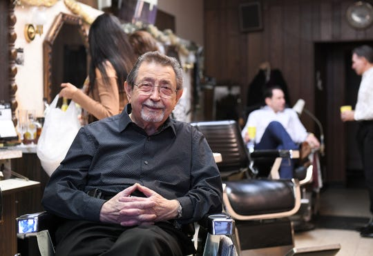 "Tony Lombardo, 88, in one of his chairs at his barbershop, Tony C's Hair Styling, in Dearborn on Sunday, Feb. 10. ""I'm sad, but I'm a little more happy,"" he said. ""I think it's time."""