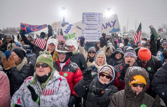 Amy Klobuchar supporters cheer as a DJ takes the stage before Sen. Amy Klobuchar's announcement announcement to run for president Sunday, Feb. 10, 2019, from a snowy Boom Park, in Minneapolis.