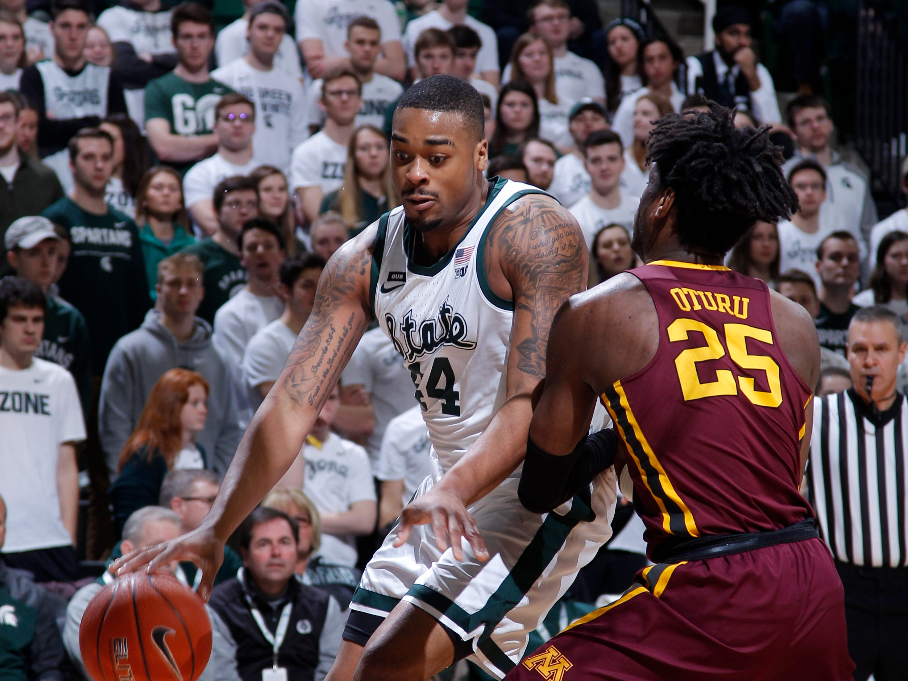 Michigan State's Nick Ward, left, drives against Minnesota's Daniel Oturu during the first half of an NCAA college basketball game, Saturday, Feb. 9, 2019, in East Lansing, Mich. Michigan State won 79-55. (AP Photo/Al Goldis)