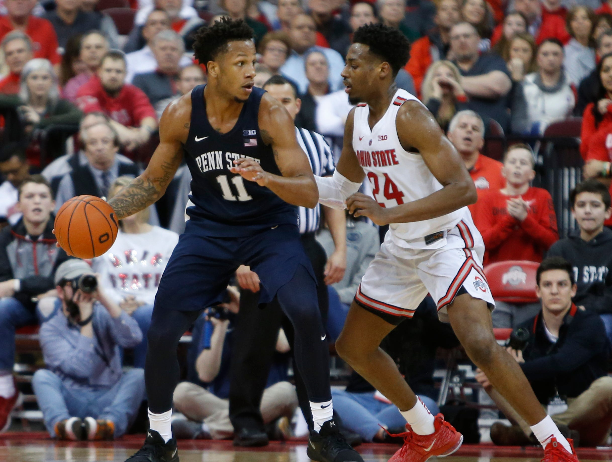 Penn State's Lamar Stevens, left, looks for an open pass as Ohio State's Andre Wesson defends during the second half of an NCAA college basketball game Thursday, Feb. 7, 2019, in Columbus, Ohio. Ohio State beat Penn State 74-70. (AP Photo/Jay LaPrete)