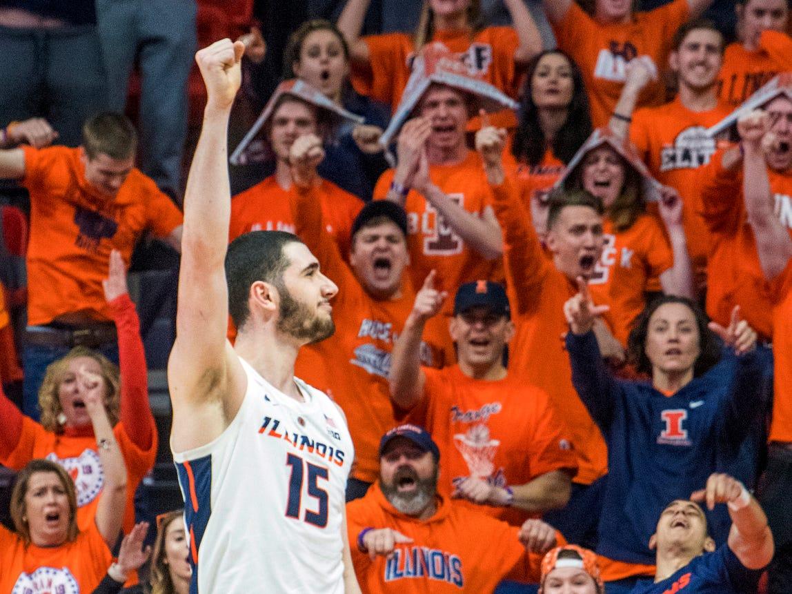 Illinois forward Giorgi Bezhanishvili (15) revs up the Orange Krush in the second half of an NCAA college basketball game against Rutgers in Champaign, Ill., Saturday, Feb. 9, 2019. (AP Photo/Robin Scholz)
