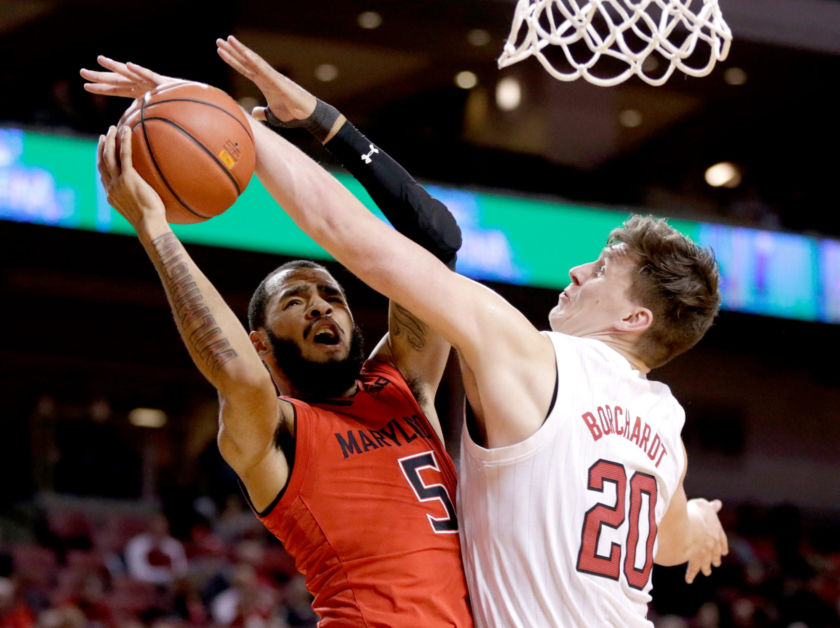 Nebraska's Tanner Borchardt (20) commits a foul while blocking a layup by Maryland's Eric Ayala (5) during the second half of an NCAA college basketball game in Lincoln, Neb., Wednesday, Feb. 6, 2019. Maryland won 60-45. (AP Photo/Nati Harnik)