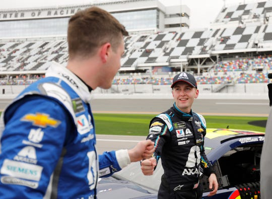 Alex Bowman, left, congratulates Daytona 500 pole winner William Byron after their qualifying runs Sunday.