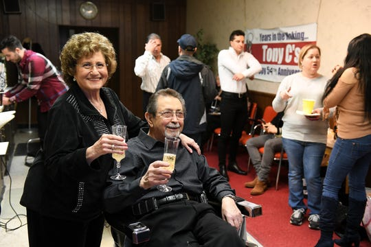 Antoinette Lombardo toasts her husband, Tony Lombardo, during a family gathering at Tony C's Hair Styling in Dearborn on Sunday, Feb. 10 in celebration of his retirement. Tony Lombardo is retiring after 60 years in the barber business.