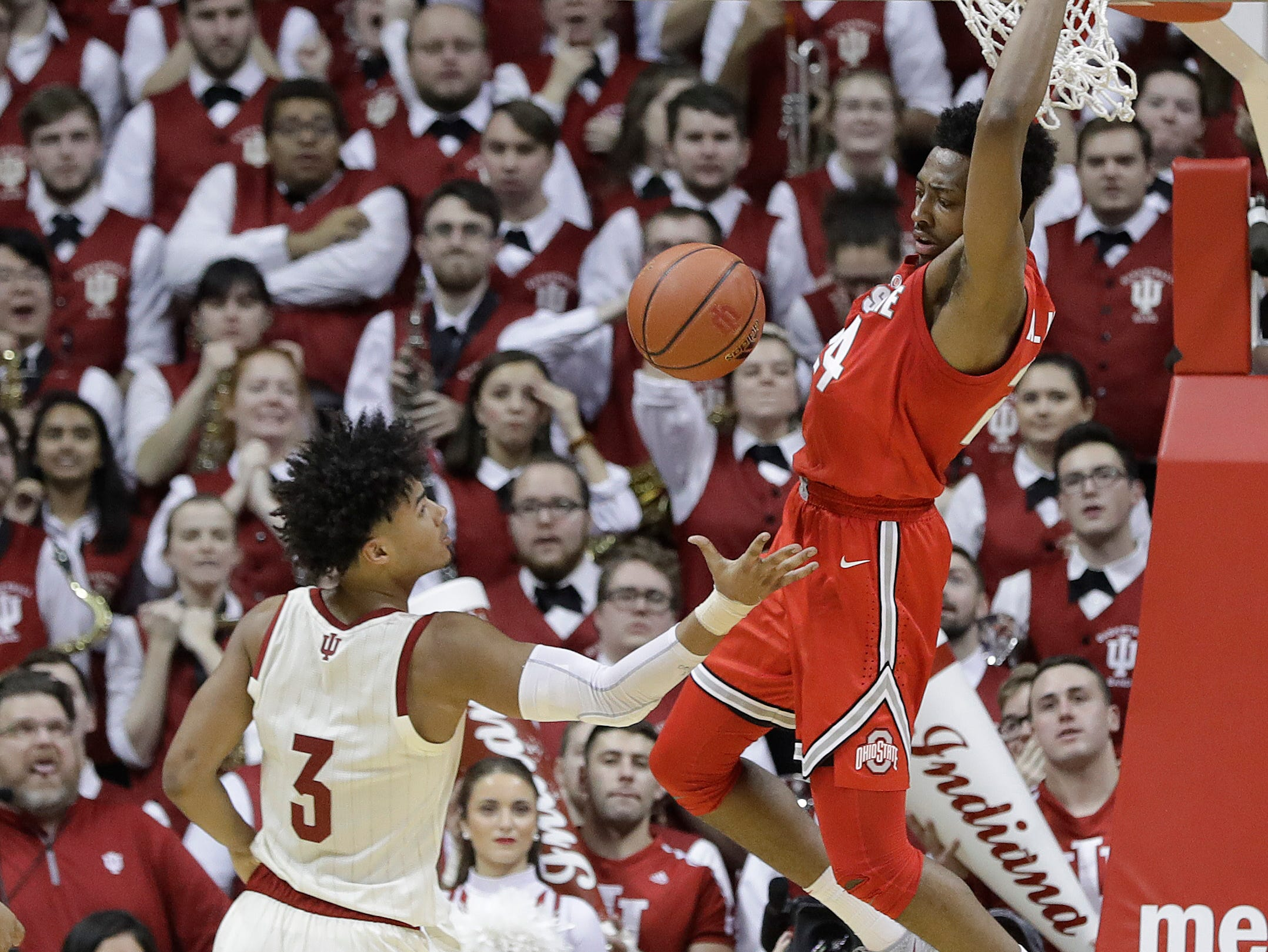 Ohio State's Andre Wesson (24) dunks and Indiana's Justin Smith (3) watches during the second half of an NCAA college basketball game, Sunday, Feb. 10, 2019, in Bloomington, Ind. Ohio State won 55-52. (AP Photo/Darron Cummings)
