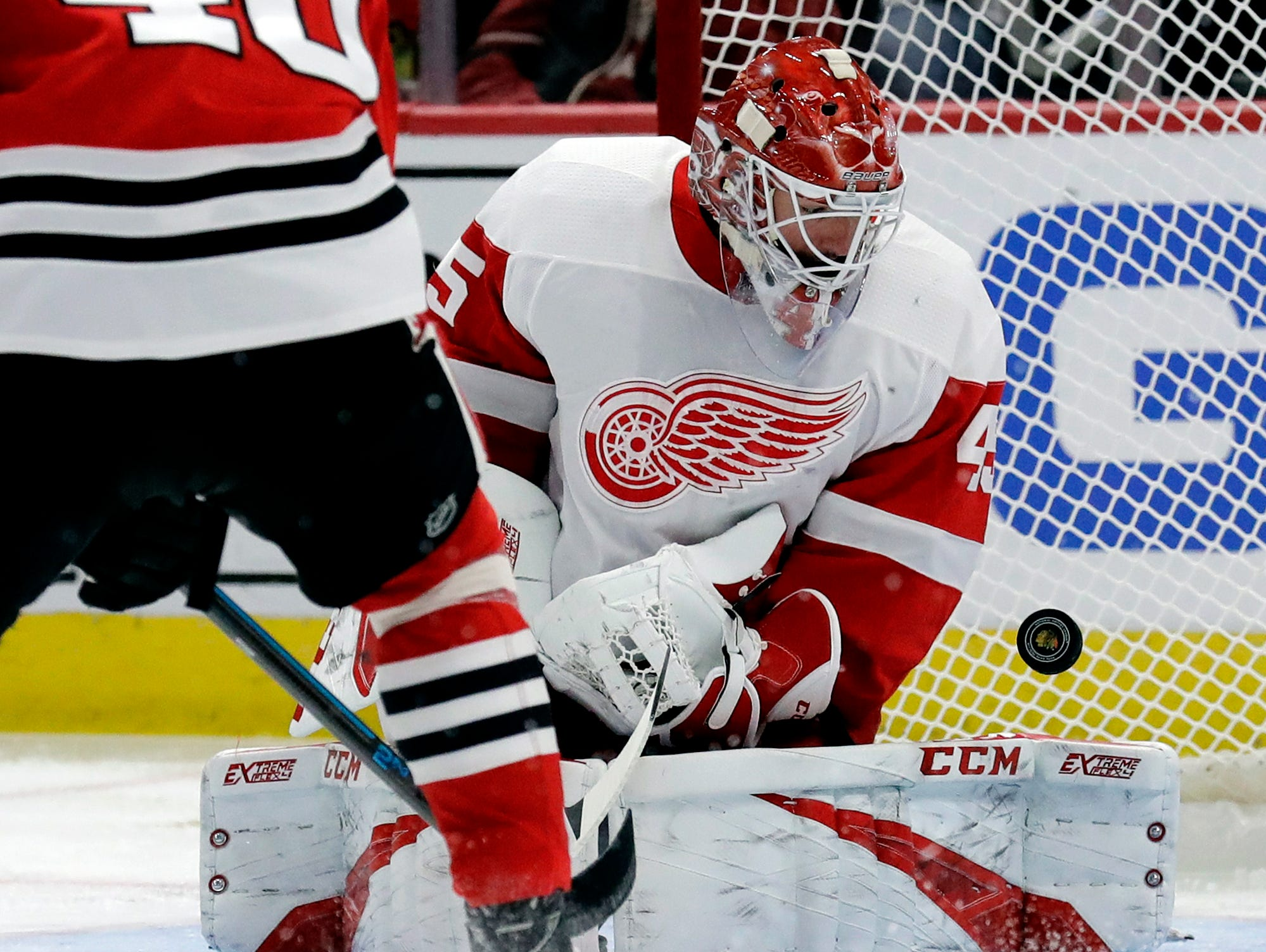 Detroit Red Wings goalie Jonathan Bernier blocks a shot against the Chicago Blackhawks during the second period of an NHL hockey game Sunday, Feb. 10, 2019, in Chicago.  Detroit lost to Chicago 5-2