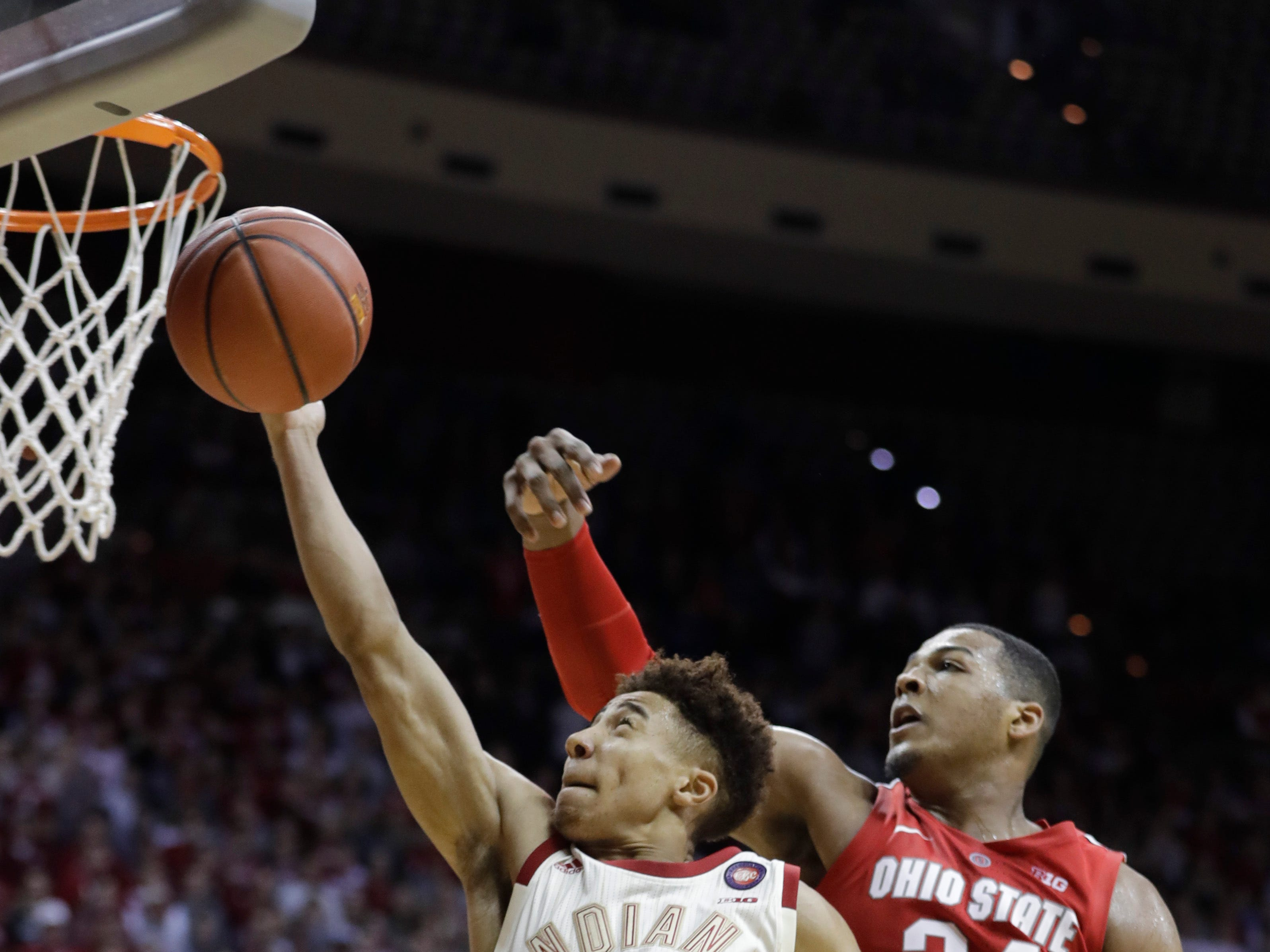 Indiana's Rob Phinisee (10) has his shot blocked by Ohio State's Kaleb Wesson (34) during the second half of an NCAA college basketball game, Sunday, Feb. 10, 2019, in Bloomington, Ind. Ohio State won 55-52. (AP Photo/Darron Cummings)