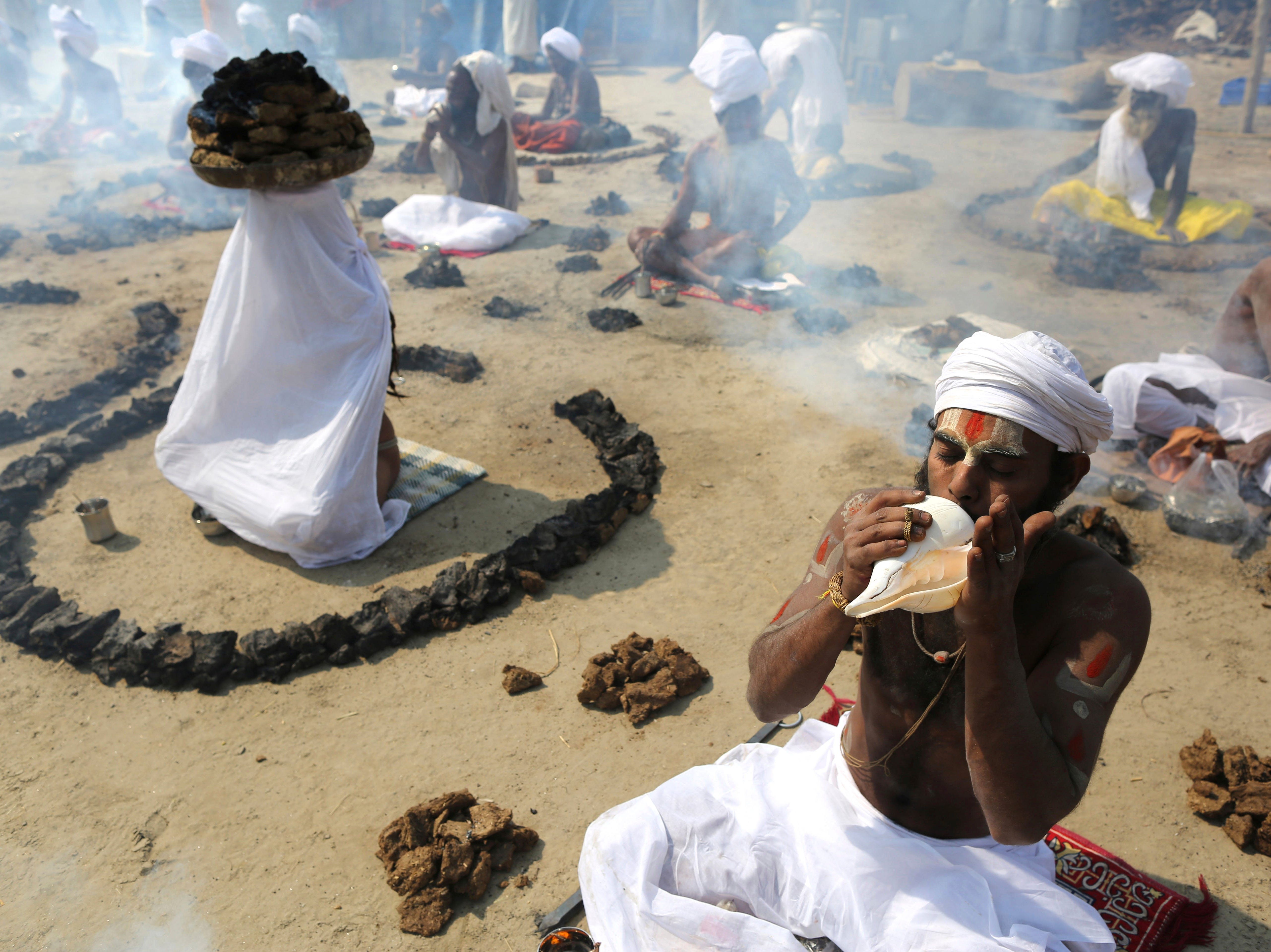 Hindu holy men perform rituals after holy dip on the auspicious day of Basant Panchami at Sangam, the confluence of sacred rivers the Yamuna, the Ganges and the mythical Saraswati, during the Kumbh Mela or the Pitcher Festival, in Prayagraj, Uttar Pradesh state, India, Sunday, Feb. 10, 2019. The Kumbh Mela is a series of ritual baths by Hindu sadhus, or holy men, and other pilgrims at Sangam that dates back to at least medieval times. Pilgrims bathe in the river believing it cleanses them of their sins and ends their process of reincarnation.