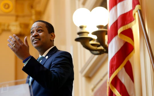Virginia Lt. Gov Justin Fairfax welcomes visitors to the gallery at the opening of the senate session at the Capitol in Richmond, Va., Thursday, Feb. 7, 2019. A California woman has accused Fairfax of sexually assaulting her 15 years ago.