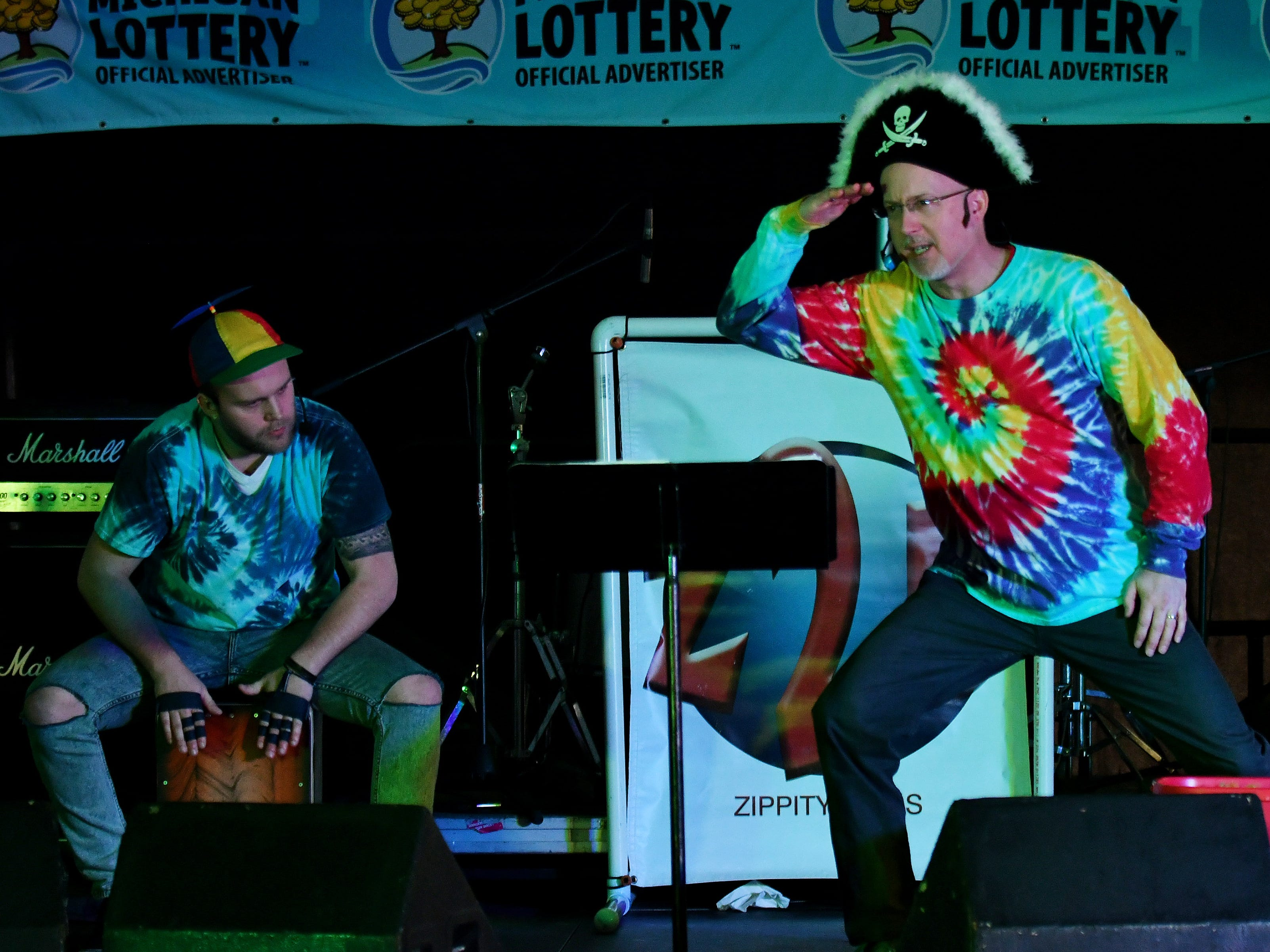 Shawn Ryskamp, 51, and his son, Austin Ryskamp, 26, left, both of Oxford, perform as Zippity 2 Dads on the Kids Stage.