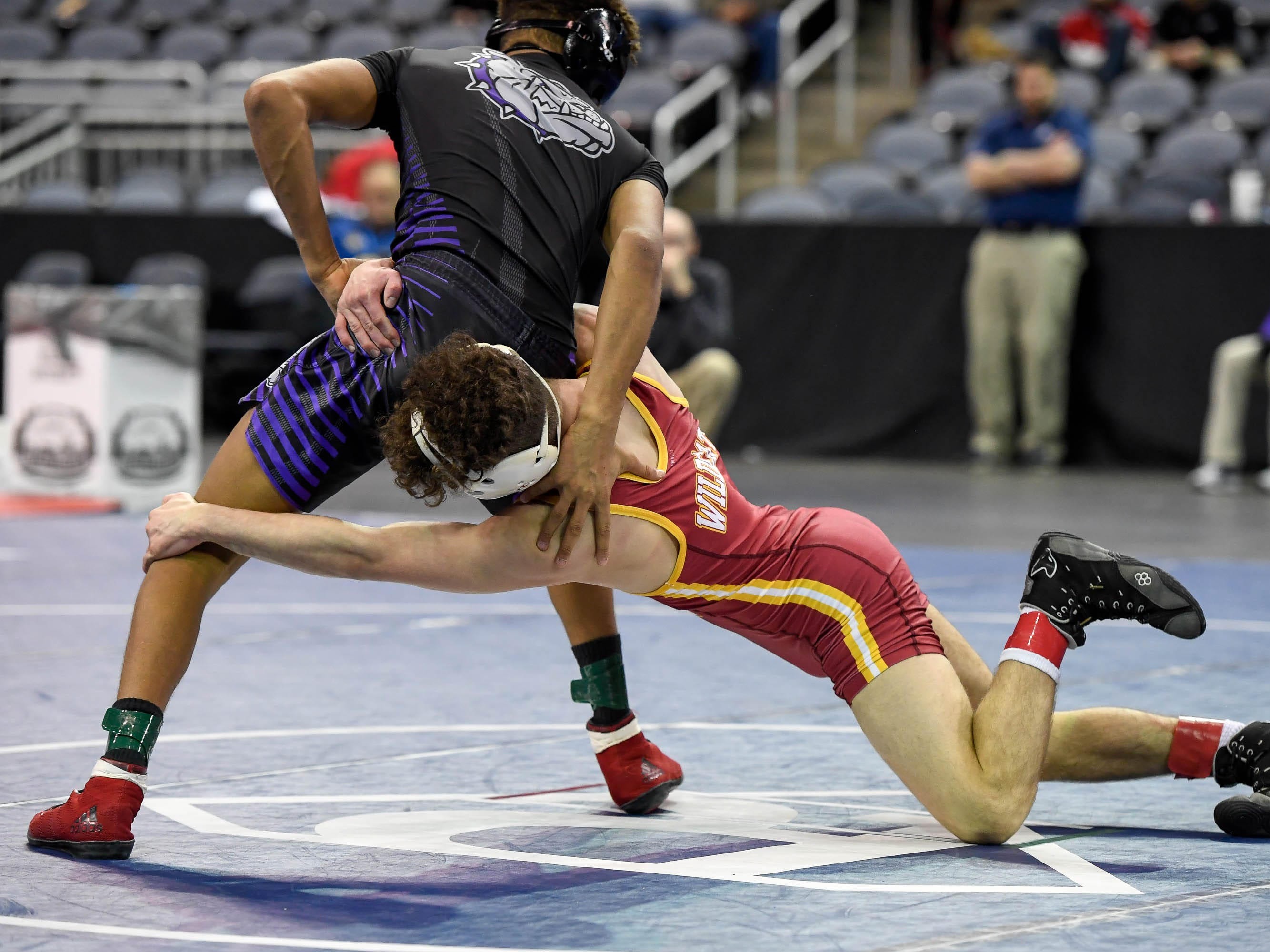 Cole Ross, Evansville Mater Dei, wrestles K.T. Nelson, Brownsburg, in the 113 weight class at the Indiana High School Athletic Association Semi-State Wrestling Tournament held at the Ford Center Saturday, February 9, 2019.