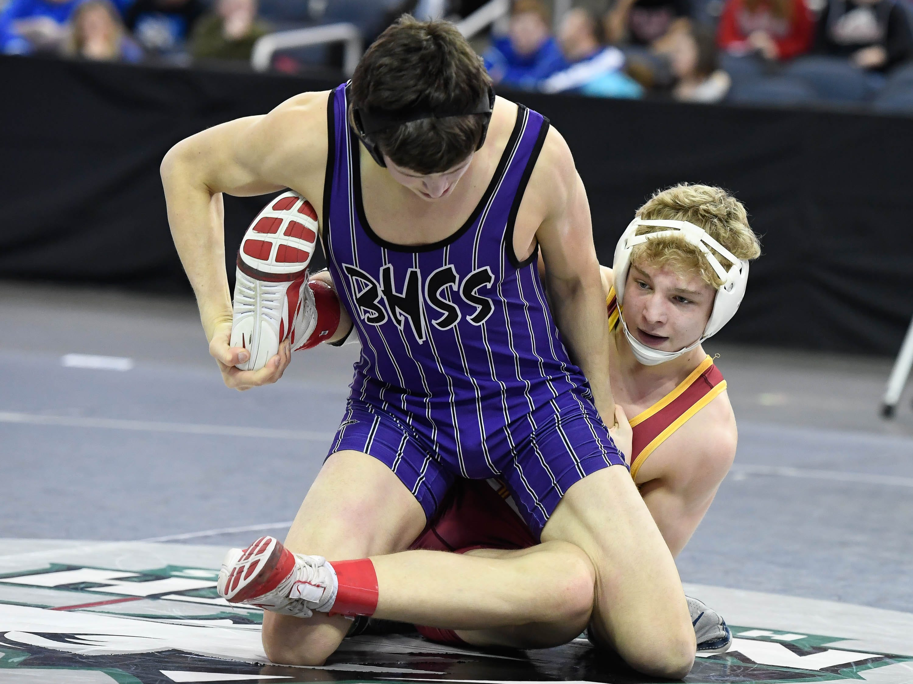 Gabe Sollars, Evansville Mater Dei, wrestles Tristan Ruhlman, Bloomington South, in the 160 weight class at the Indiana High School Athletic Association Semi-State Wrestling Tournament held at the Ford Center Saturday, February 9, 2019.