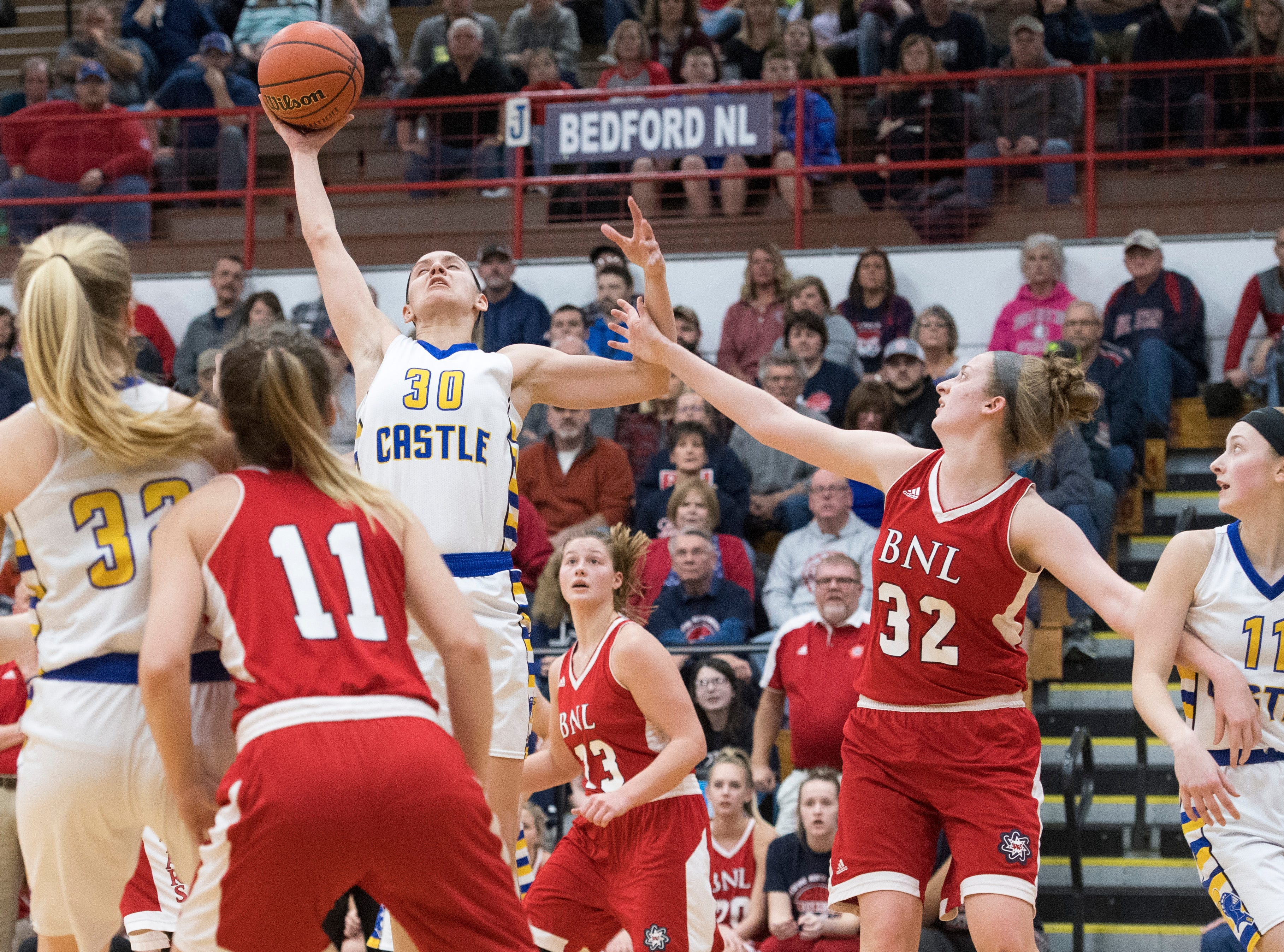 Castle's Jessica Nunge (30) reaches for a rebound during the  IHSAA Girls Basketball Class 4A Regional Championship game against the Bedford North Lawrence Lady Stars at the Stars Field House in Bedford, Ind. Saturday, Feb. 9, 2019.