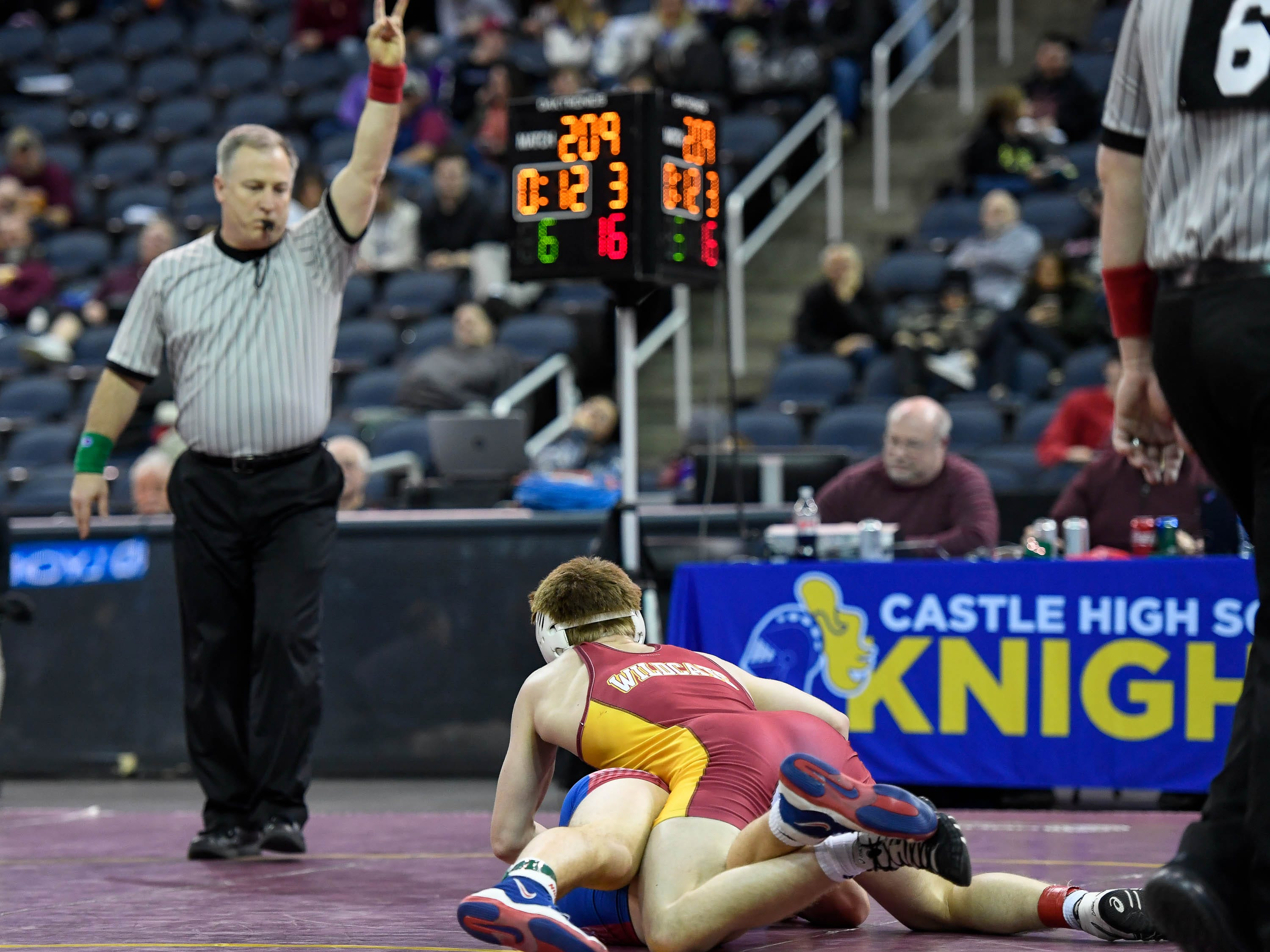Mater Dei's Matthew Lee scores points as he wrestles L.J. Burdon, Plainfield, in the 145 weight class of the finals of the Indiana High School Athletic Association Semi-State Wrestling Tournament held at the Ford Center Saturday, February 9, 2019.