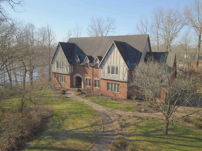 This 6,000-plus square-foot tudor-style home on Kahre Lake is a spacious retreat on five acres that still offers the convenience of being close to shopping and schools.