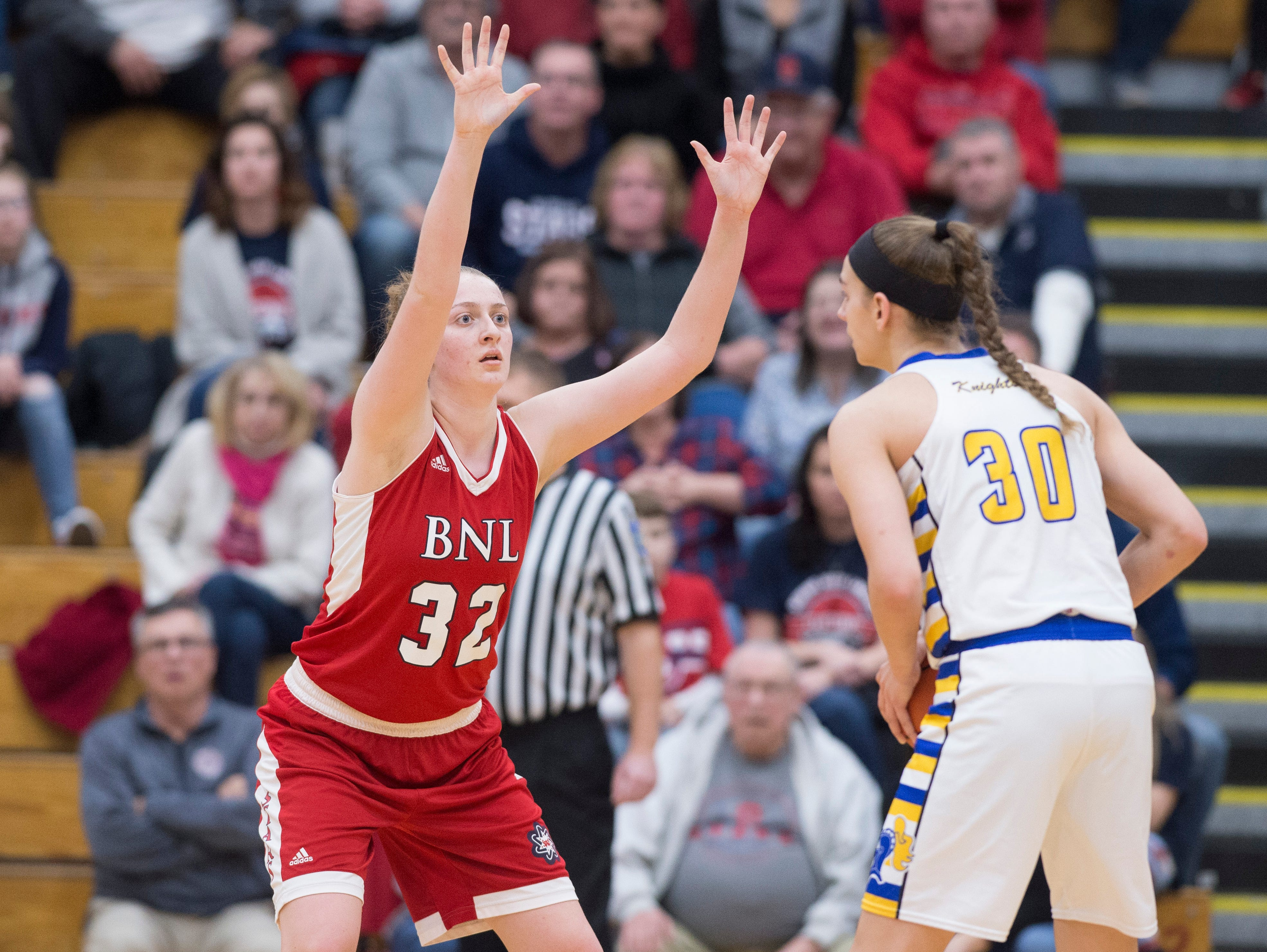 Bedford North Lawrence's Madison Webb (32) guards Castle's Jessica Nunge (30) during the IHSAA Girls Basketball Class 4A Regional Championship game against the Castle Knights at the Stars Field House in Bedford, Ind. Saturday, Feb. 9, 2019.