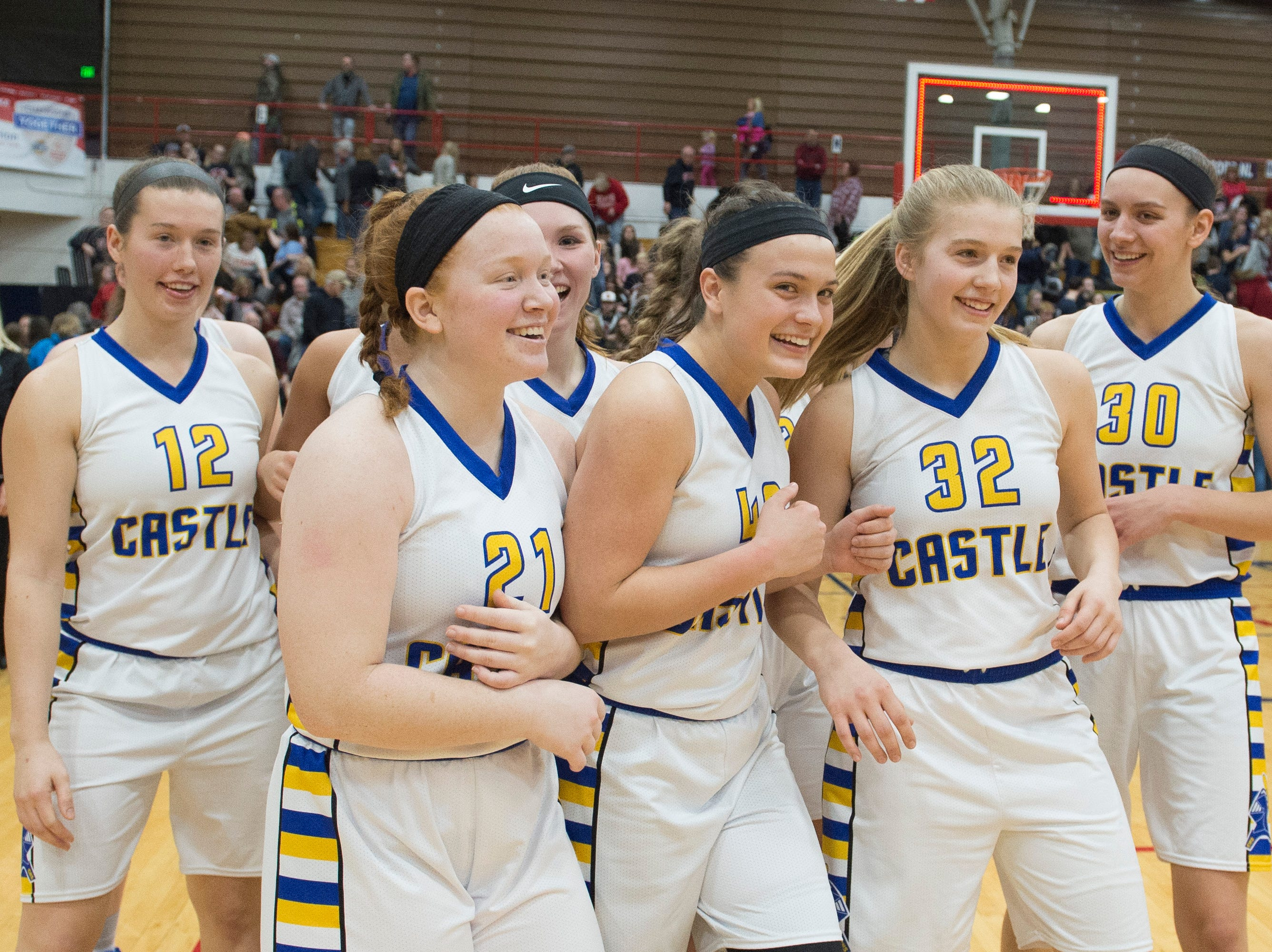 The Castle Knights gather as they celebrate their IHSAA Girls Basketball Class 4A Regional Championship game win over the Bedford North Lawrence Lady Stars at the Stars Field House in Bedford, Ind. Saturday, Feb. 9, 2019.