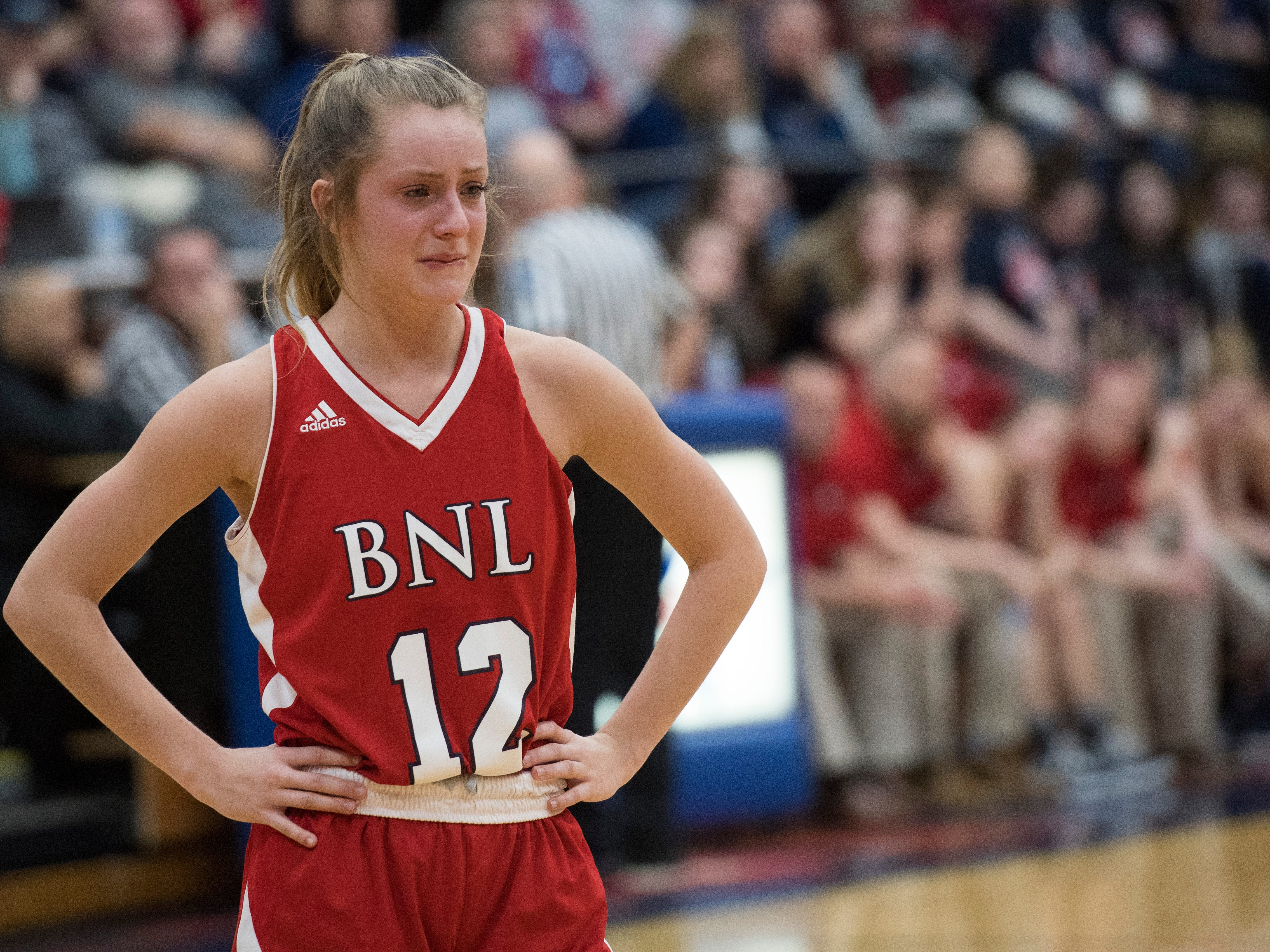 Bedford North Lawrence's Jacy Hughes (12) gets emotional on the court before the end of the IHSAA Girls Basketball Class 4A Regional Championship game against the Castle Knights at the Stars Field House in Bedford, Ind. Saturday, Feb. 9, 2019. Bedford North Lawrence lost, 54-48.