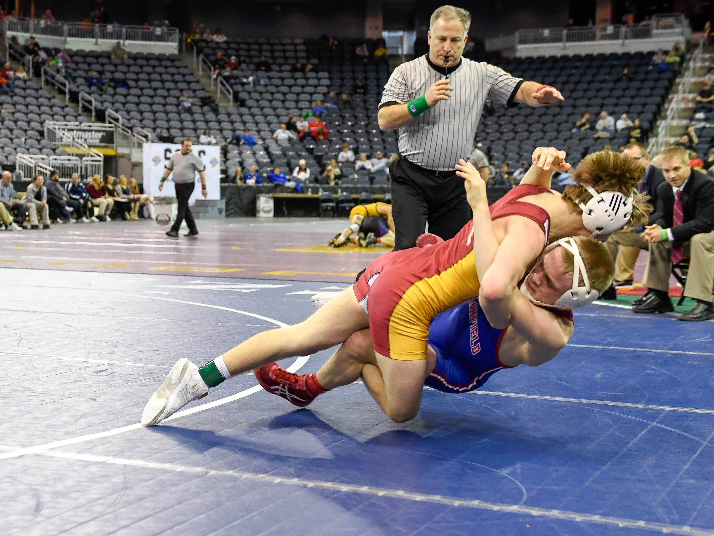 Flying out of the ring, Clay Egll, Mater Dei, wrestles Logan Boe, Plainfield, for third place in the 132 weight class at the finals of the Indiana High School Athletic Association Semi-State Wrestling Tournament held at the Ford Center Saturday, February 9, 2019.
