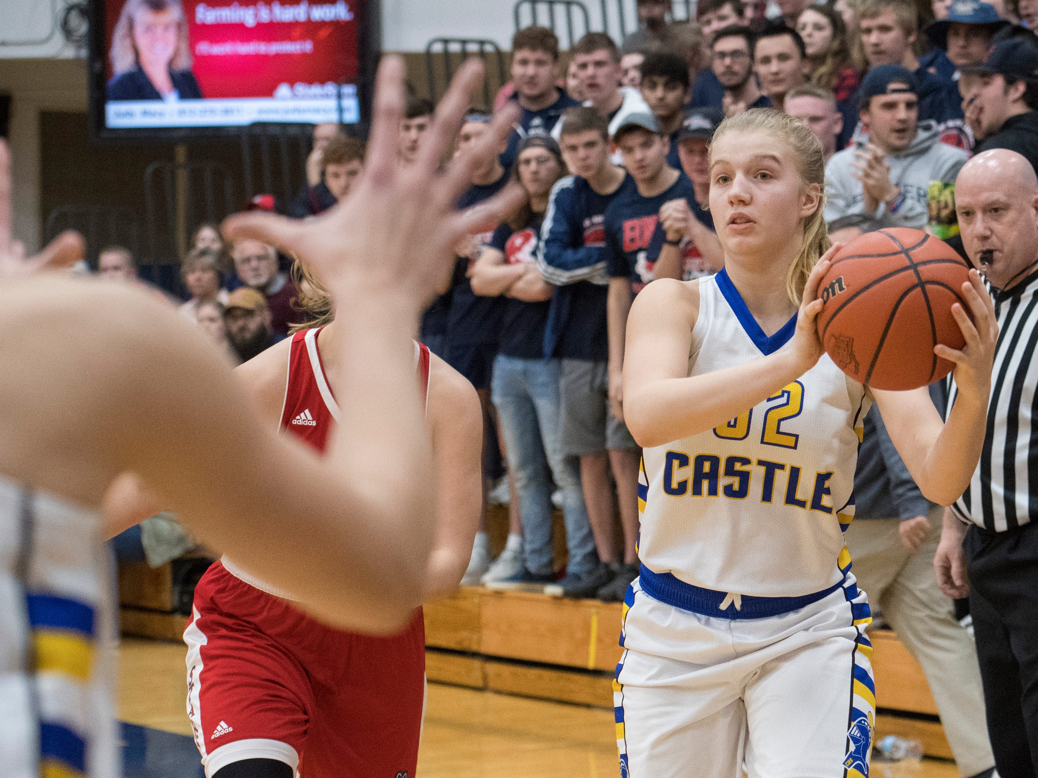 Castle's Natalie Niehaus (32) passes the ball during the I IHSAA Girls Basketball Class 4A Regional Championship game against the Bedford North Lawrence Lady Stars at the Stars Field House in Bedford, Ind. Saturday, Feb. 9, 2019.