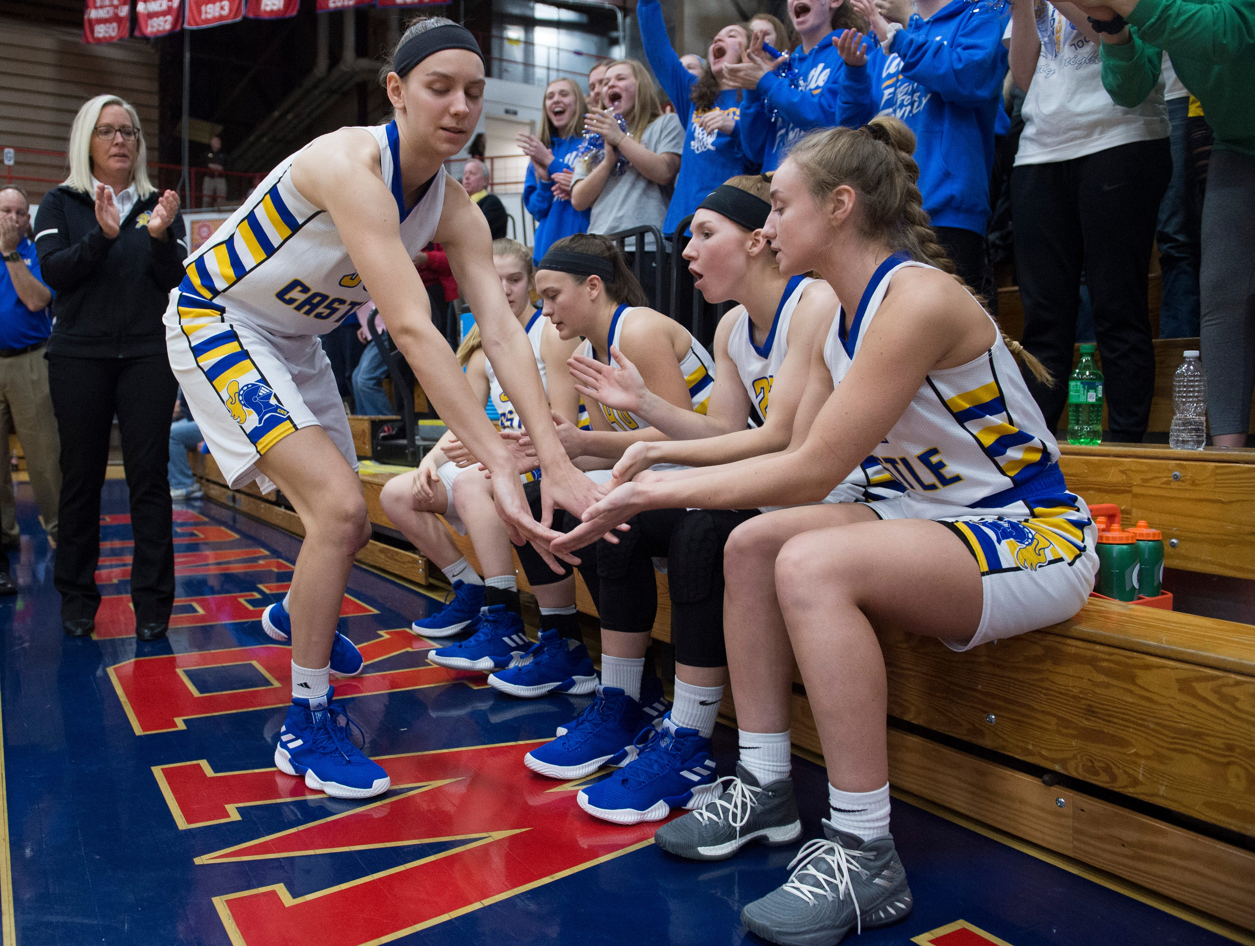 Castle's Jessica Nunge (30) slaps hands with teammates as she is called to the court before the  IHSAA Girls Basketball Class 4A Regional Championship game against the Bedford North Lawrence Lady Stars at the Stars Field House in Bedford, Ind. Saturday, Feb. 9, 2019.