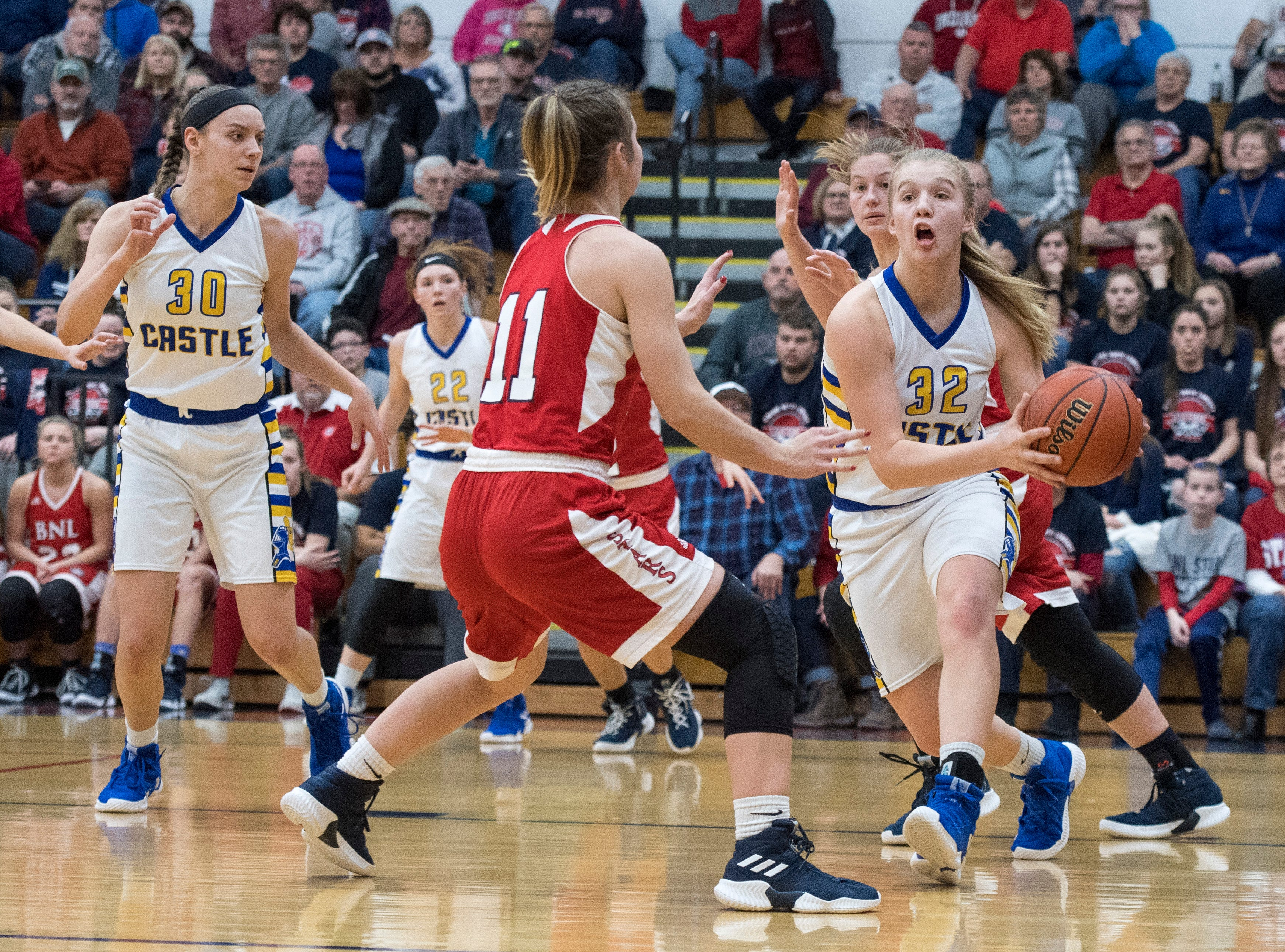 Castle's Natalie Niehaus (32) passes the ball during the  IHSAA Girls Basketball Class 4A Regional Championship game against the Bedford North Lawrence Lady Stars at the Stars Field House in Bedford, Ind. Saturday, Feb. 9, 2019.