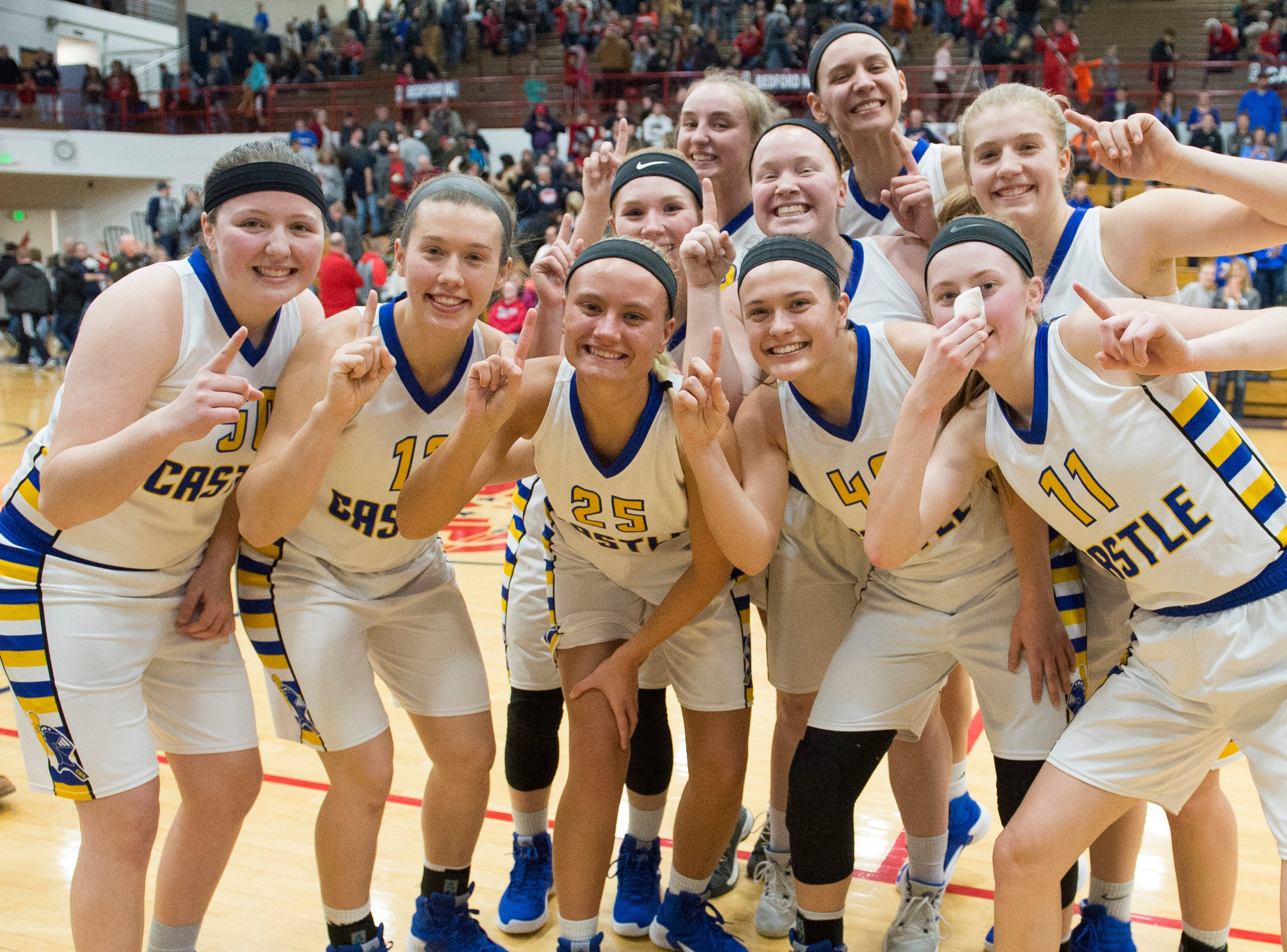 The Castle Knights pose for group shot as they celebrate their IHSAA Girls Basketball Class 4A Regional Championship game win over the Bedford North Lawrence Lady Stars at the Stars Field House in Bedford, Ind. Saturday, Feb. 9, 2019.