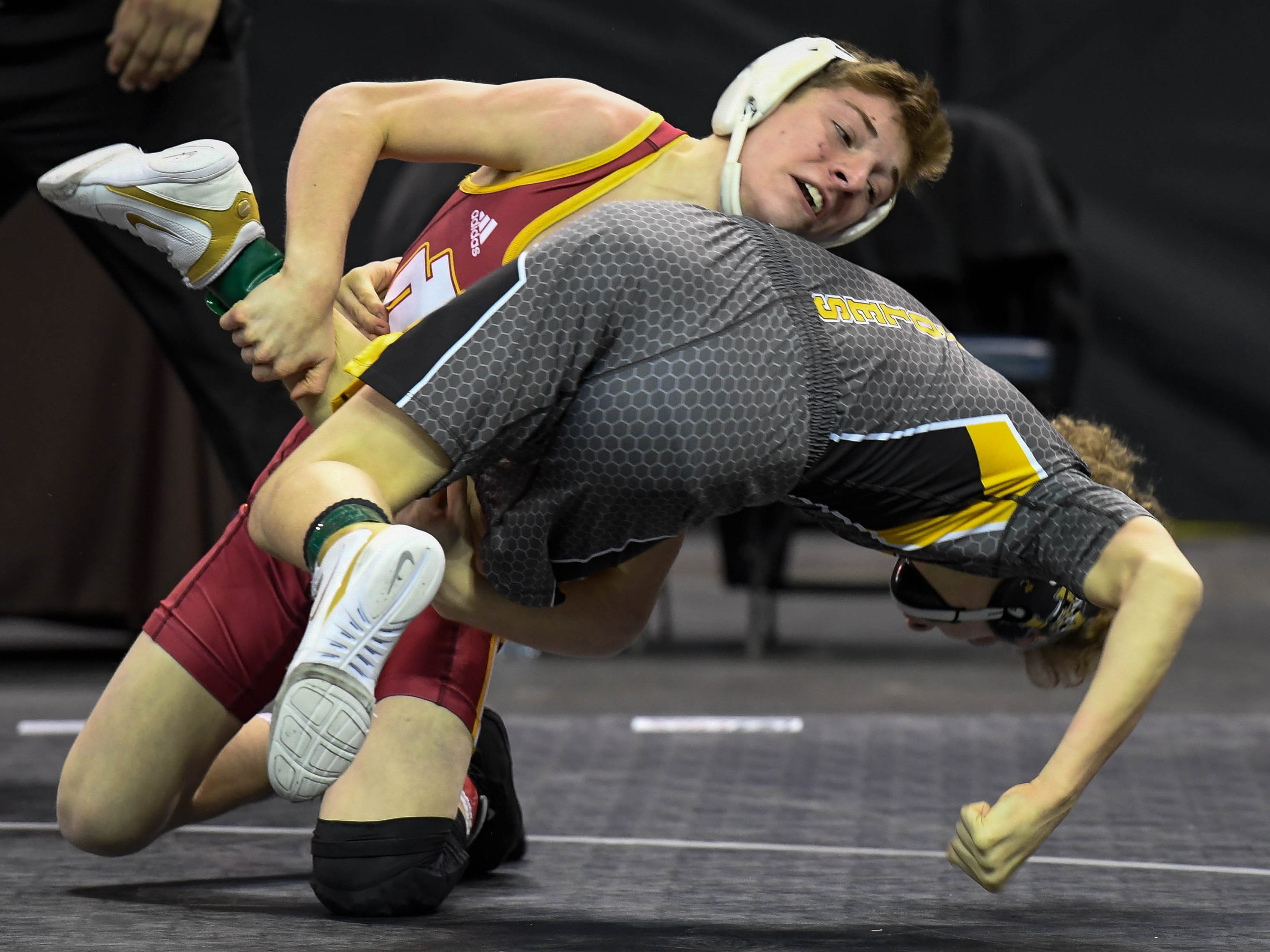 Alec Freeman, Evansville Mater Dei wrestles Blaze Garcia, Avon, in the 106 weight class at  the Indiana High School Athletic Association Semi-State Wrestling Tournament held at the Ford Center Saturday, February 9, 2019.