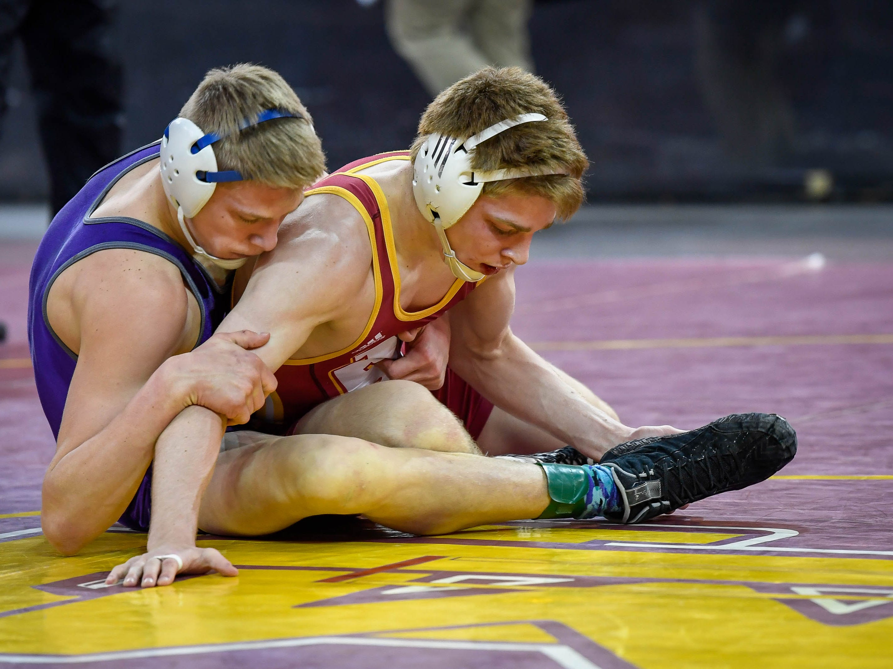 Matthew Lee, Evansville Mater Dei, wrestles Brach Carrington, Greencastle, in the 145 weight class at the Indiana High School Athletic Association Semi-State Wrestling Tournament held at the Ford Center Saturday, February 9, 2019.