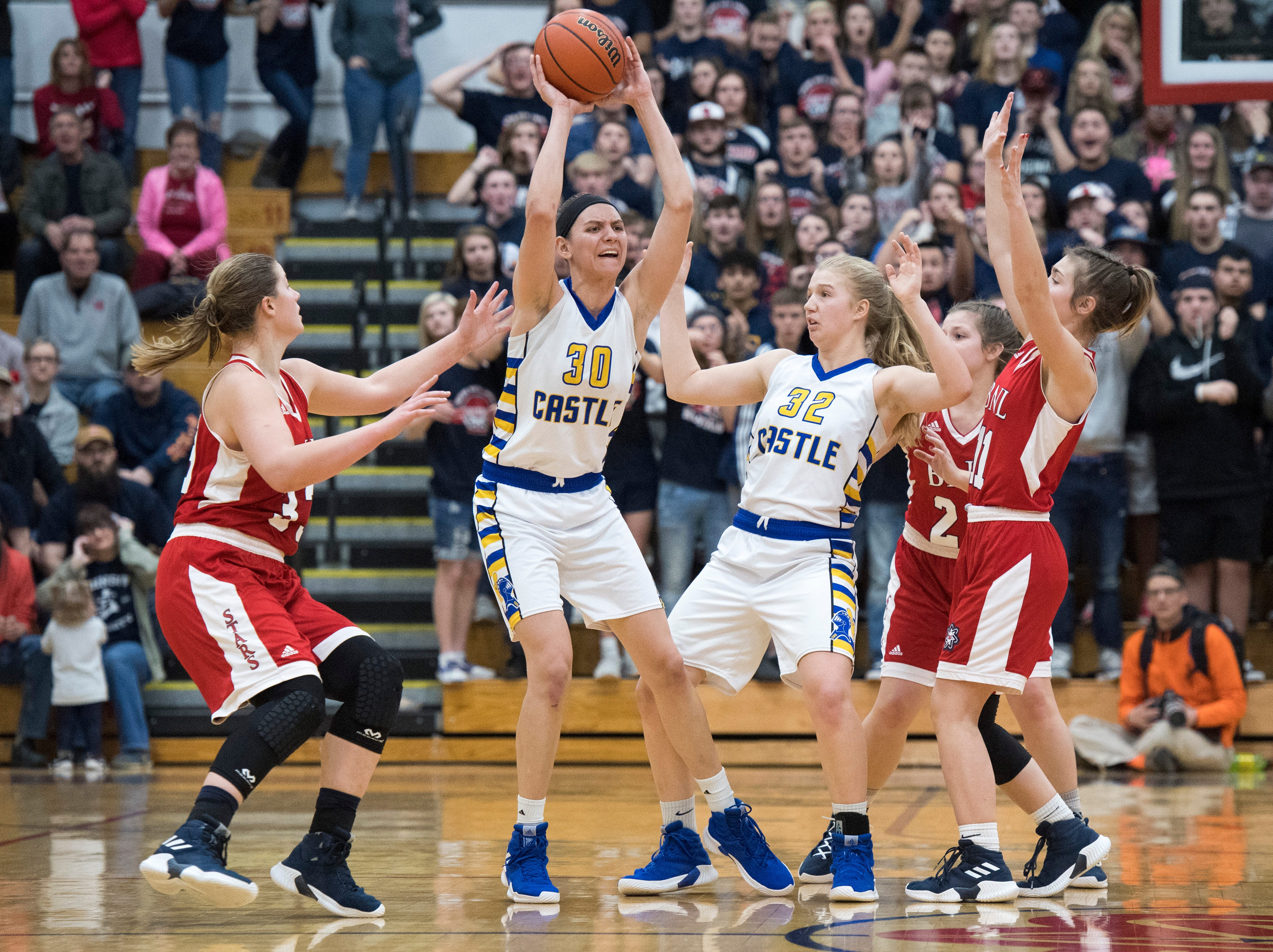 Castle's Jessica Nunge (30) passes the ball during the IIHSAA Girls Basketball Class 4A Regional Championship game against the Bedford North Lawrence Lady Stars at the Stars Field House in Bedford, Ind. Saturday, Feb. 9, 2019.
