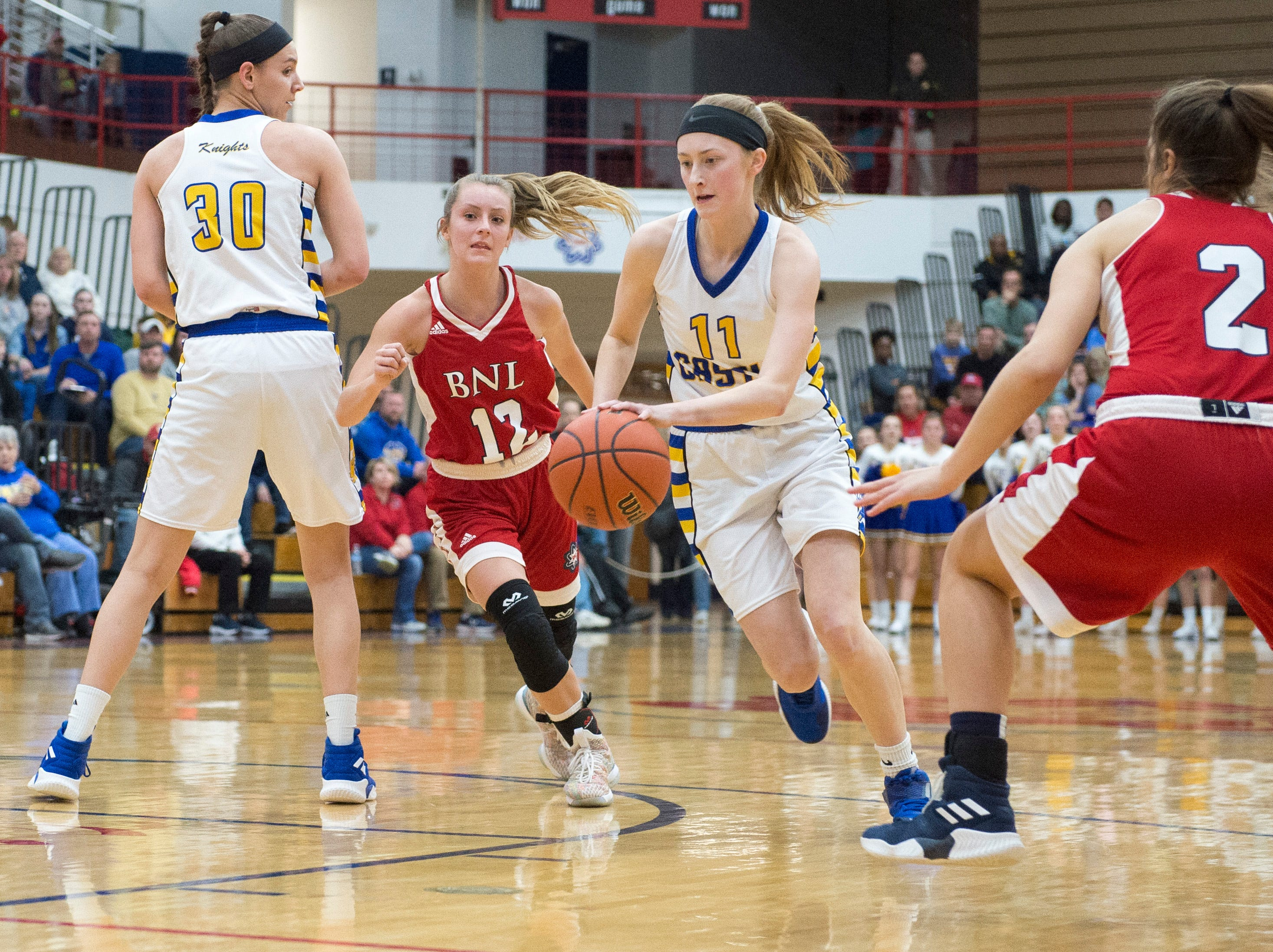 Castle's Carly Harpenau (11) gets around Bedford North Lawrence defense during the  IHSAA Girls Basketball Class 4A Regional Championship game against the Bedford North Lawrence Lady Stars at the Stars Field House in Bedford, Ind. Saturday, Feb. 9, 2019.