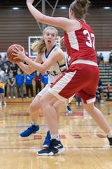 Castle's Natalie Niehaus powers through Bedford North Lawrence's defense in the Knights' 54-48 win in the Class 4A BNL Regional championship game. She had 11 points.