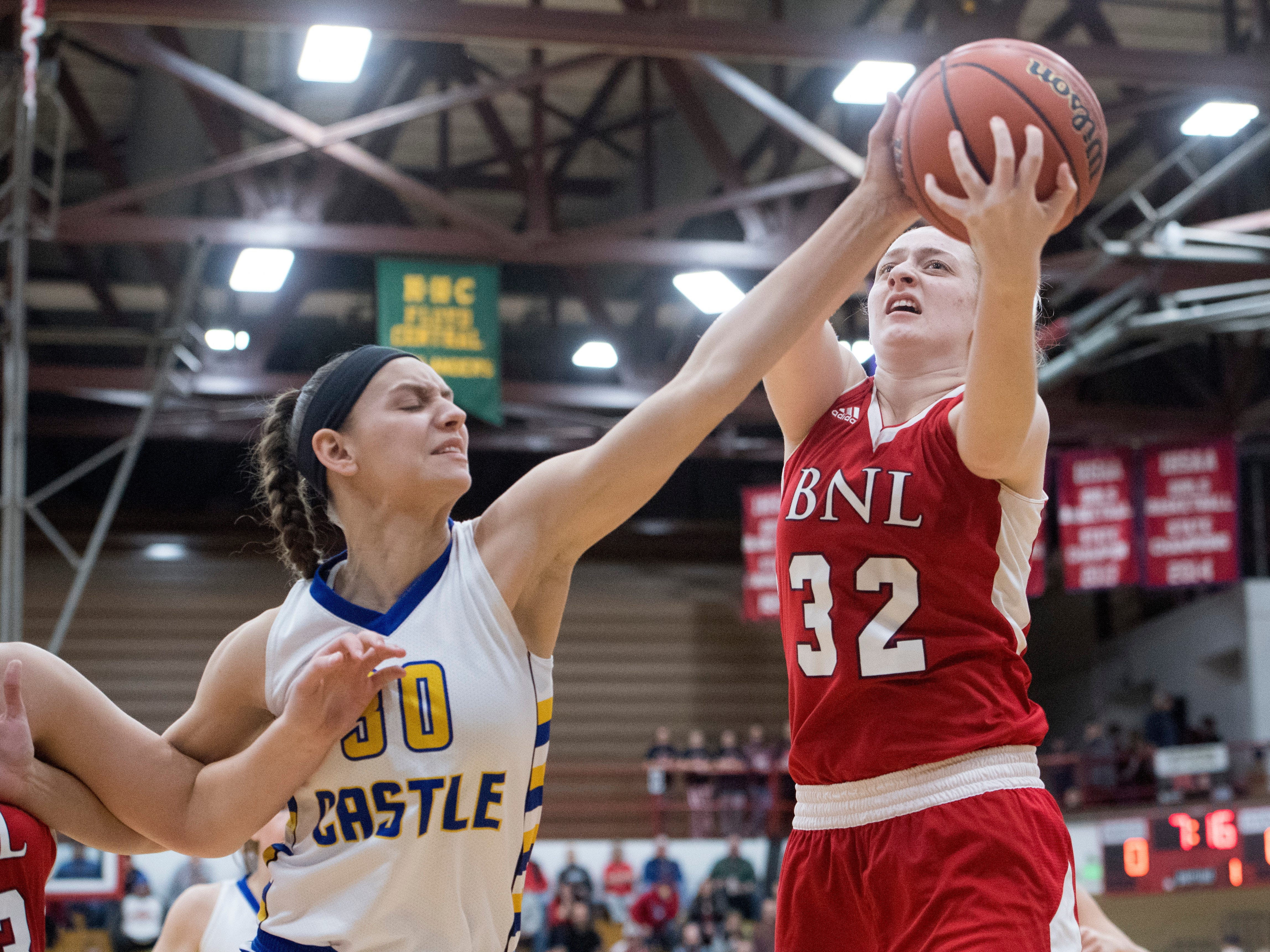 Bedford North Lawrence's Madison Webb (32) pulls down a rebound during the  IHSAA Girls Basketball Class 4A Regional Championship game against the Castle Knights at the Stars Field House in Bedford, Ind. Saturday, Feb. 9, 2019.